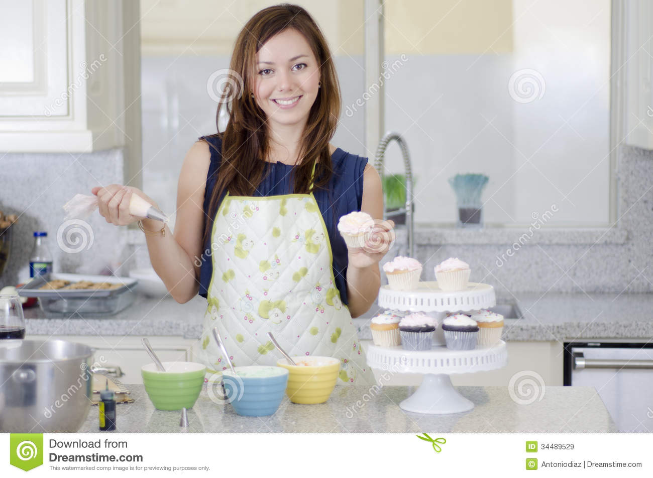 royalty free stock photo download beautiful woman making cupcakes - Woman Decorating Cupcakes