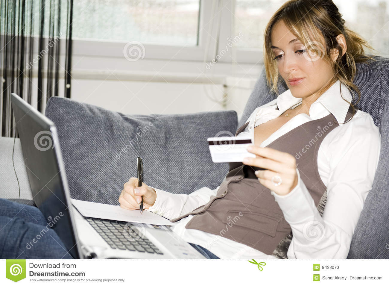 Beautiful woman making payment by credit card