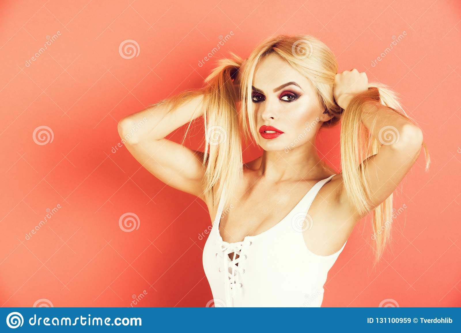 Beautiful woman model or sensual glamour portrait with makeup has red lips color and clean healthy skin face