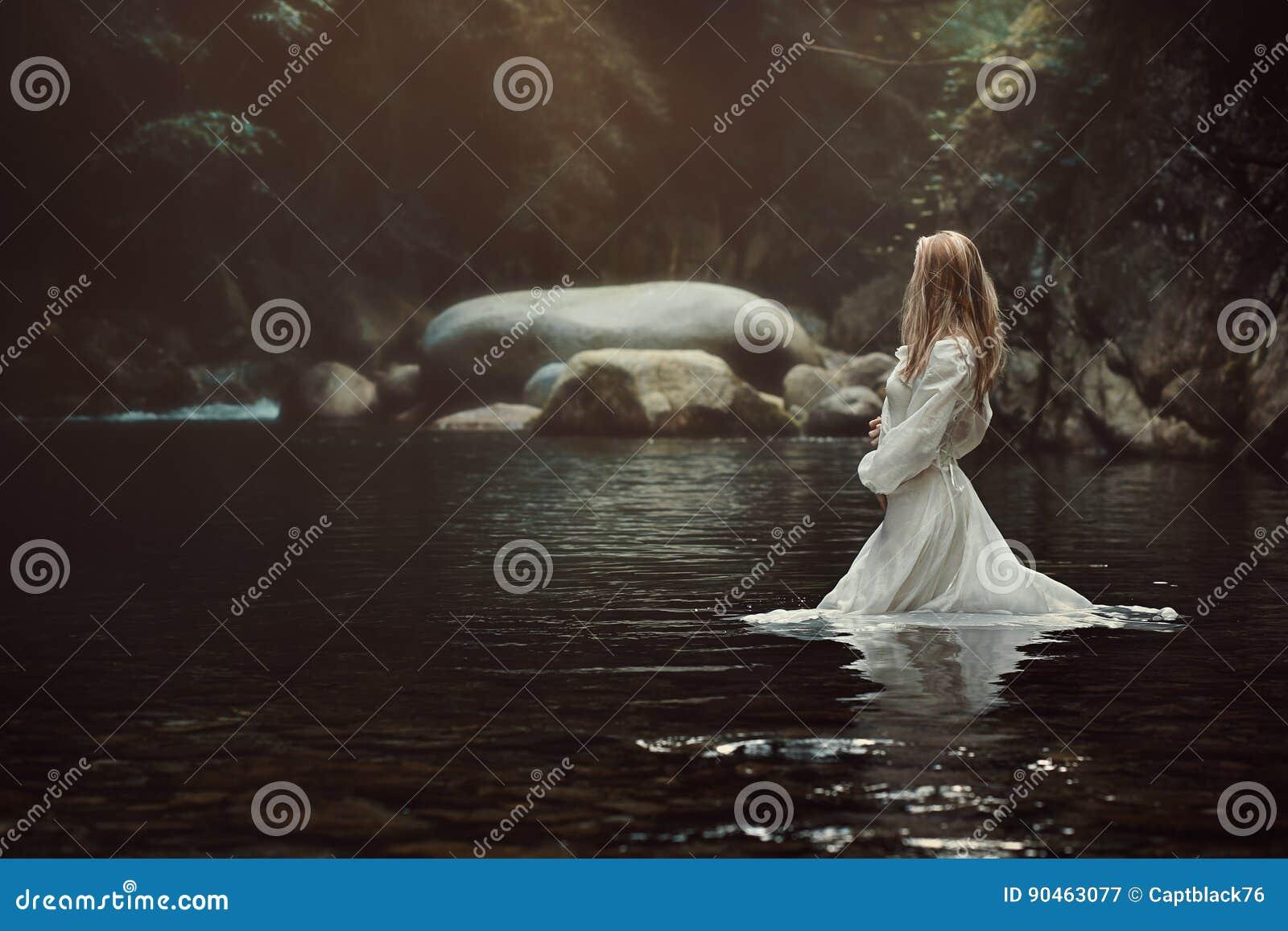 Beautiful woman in mystical stream