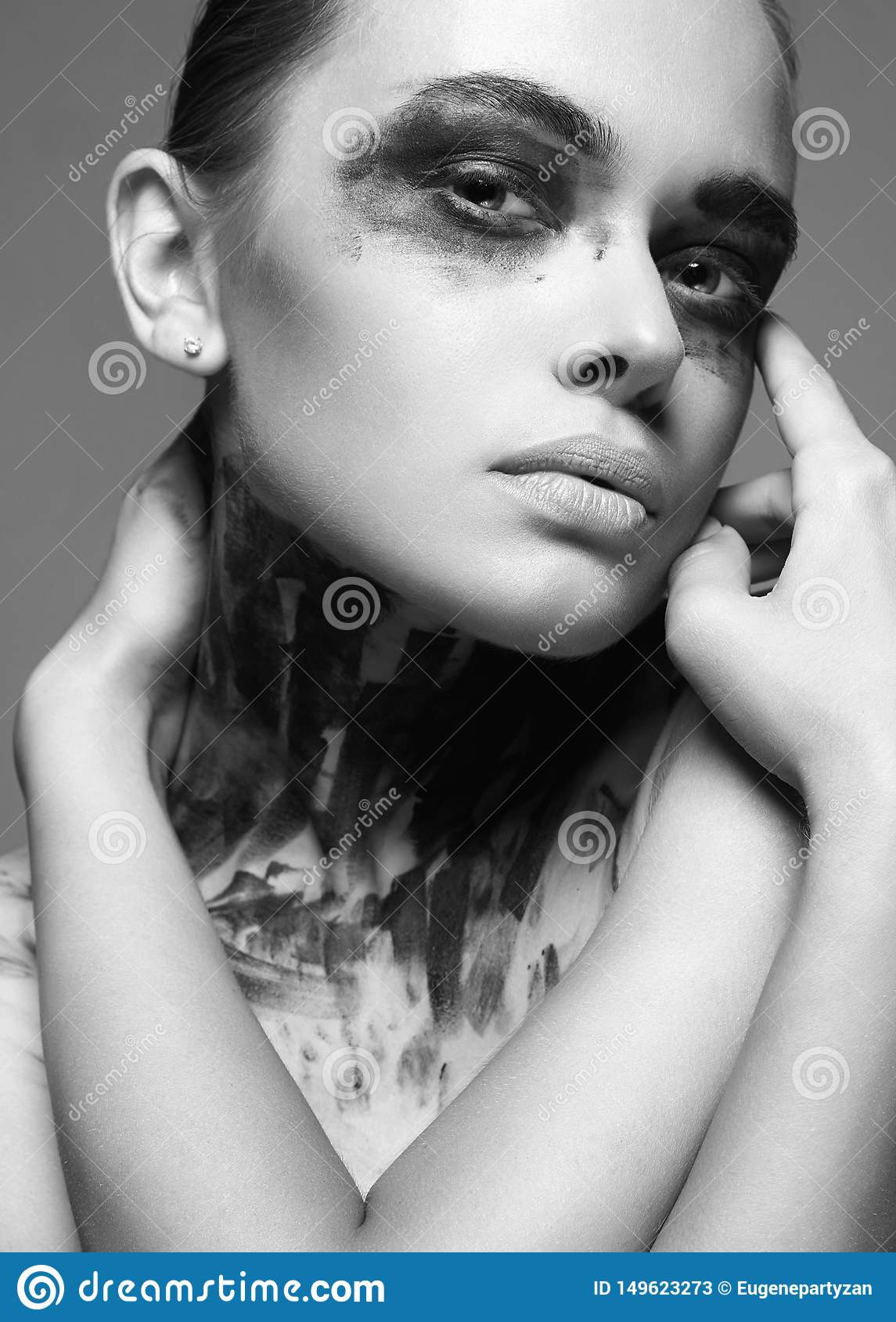 Beautiful woman with Paint Face. Halloween style dirty makeup Girl