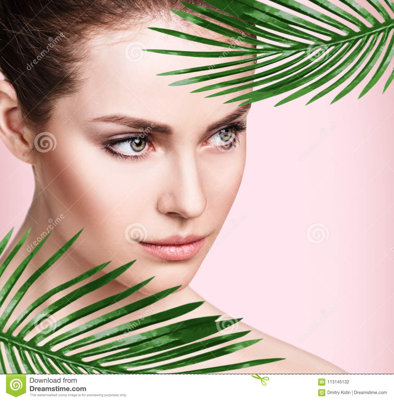 7e6b0866a68aa Beautiful Woman With Perfect Skin Among Palm Leaves. Stock Photo ...
