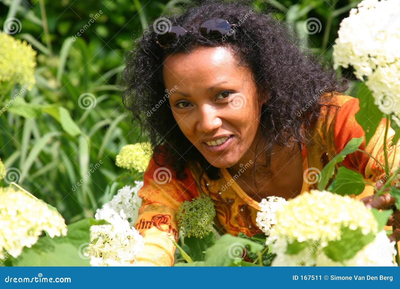 Beautiful woman picking flowers