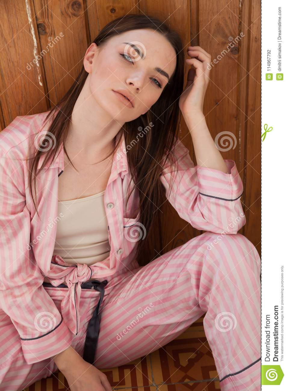 21f4bb36d1d7 Beautiful Woman In Pink Pajamas In The Bedroom Stock Photo - Image ...