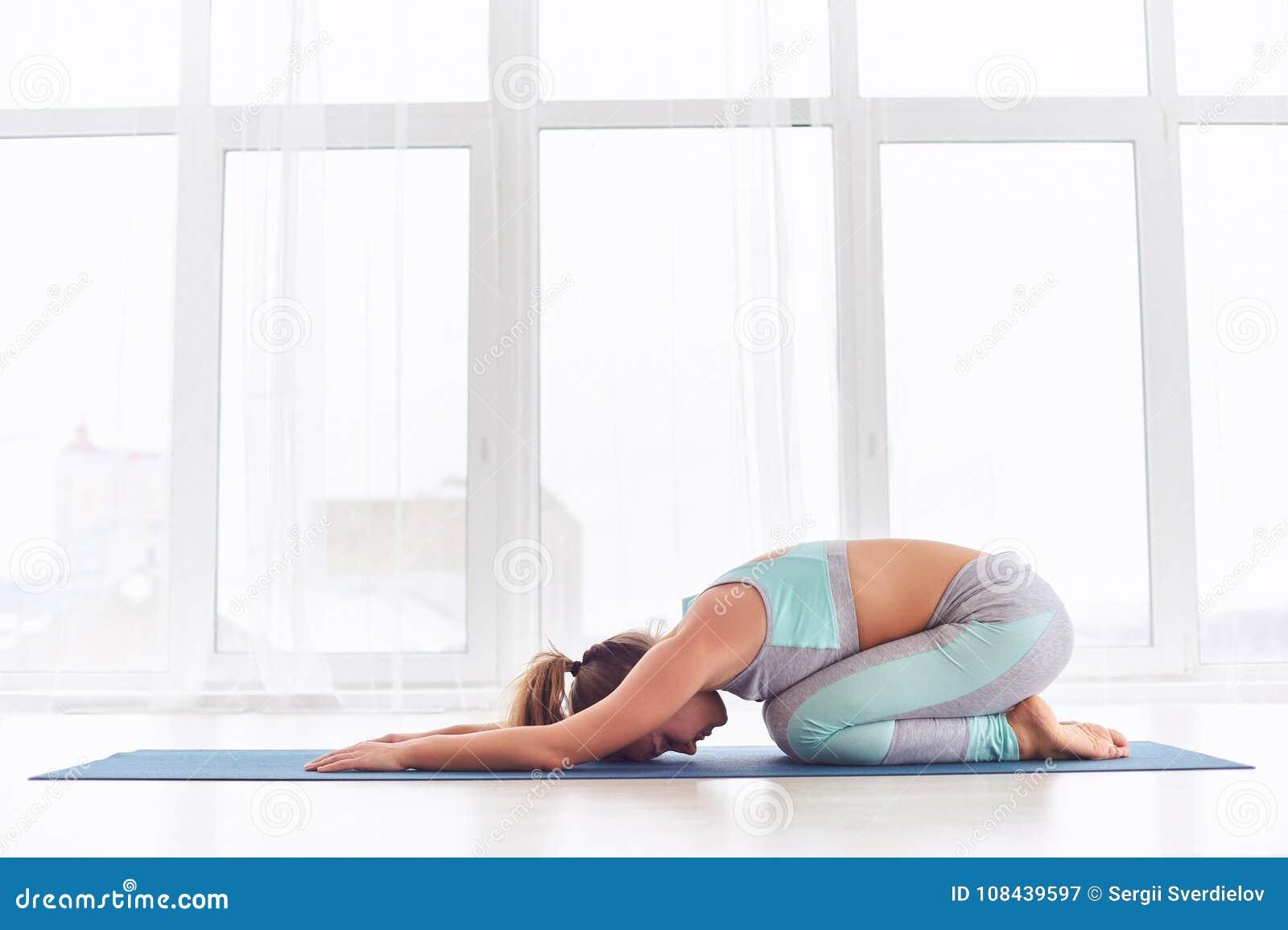 Beautiful Woman Practices Yoga Asana Balasana   Child`s Pose At ...