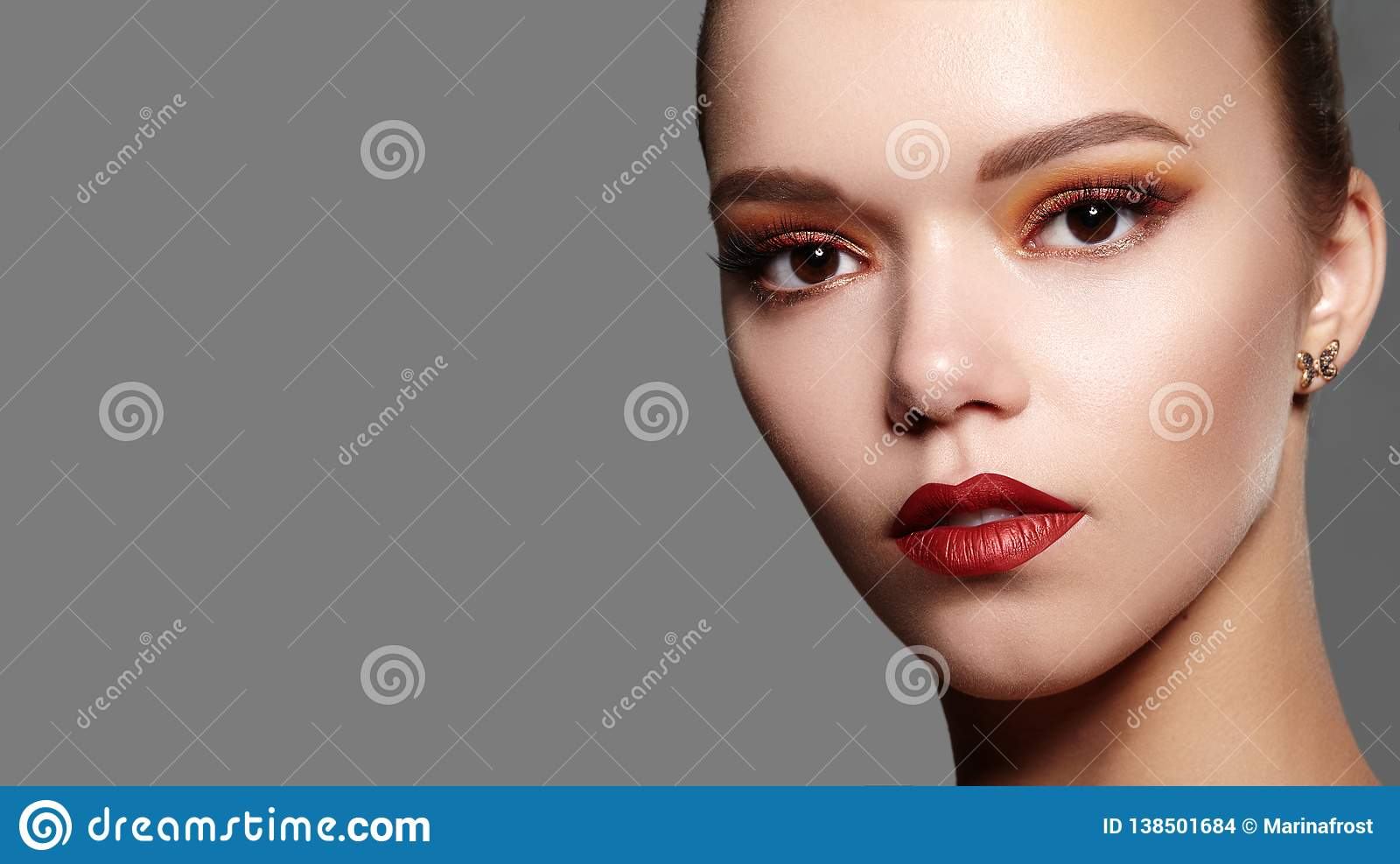 Beautiful Woman with Professional Makeup. Celebrate Style Eye Make-up, Perfect Eyebrows, Shine Skin. Bright Fashion Look