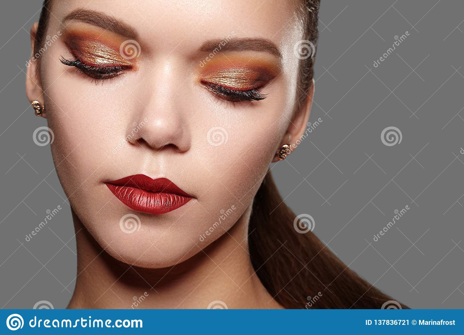 b492f9546ce Beautiful Woman with Professional Makeup. Party Gold Eye Make-up, Perfect  Eyebrows,