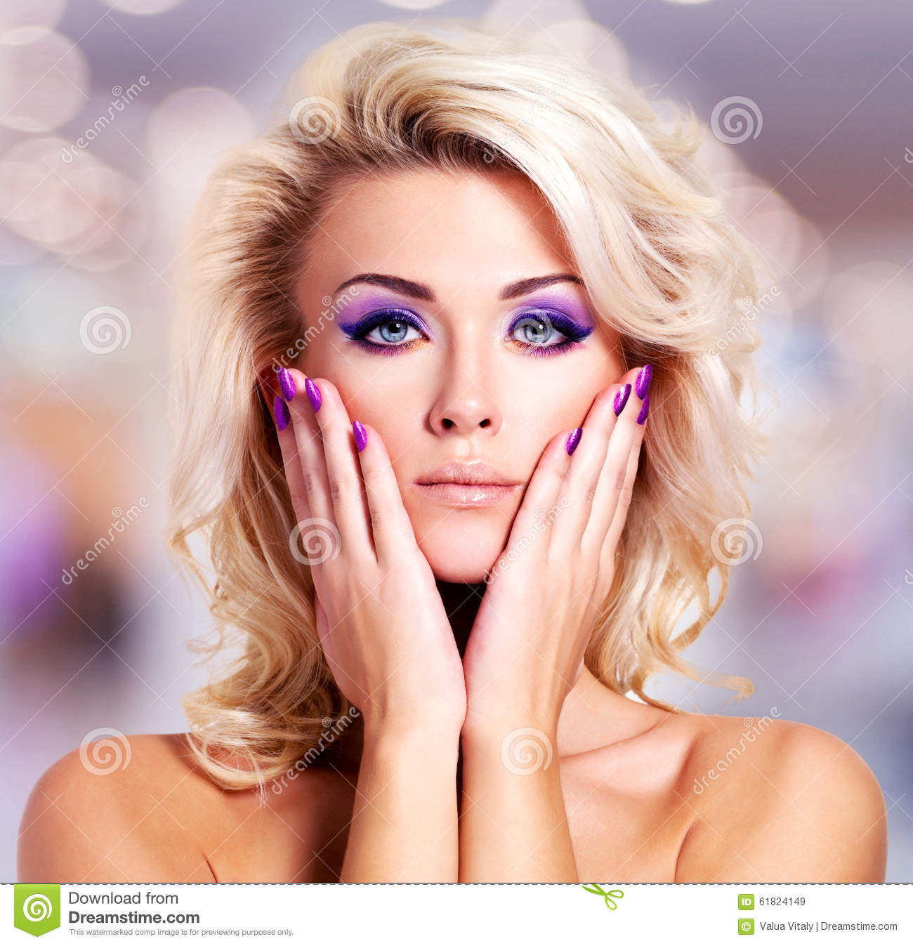 Beautiful Woman With Purple Nails And Glamour Makeup Stock Photo - Image 61824149