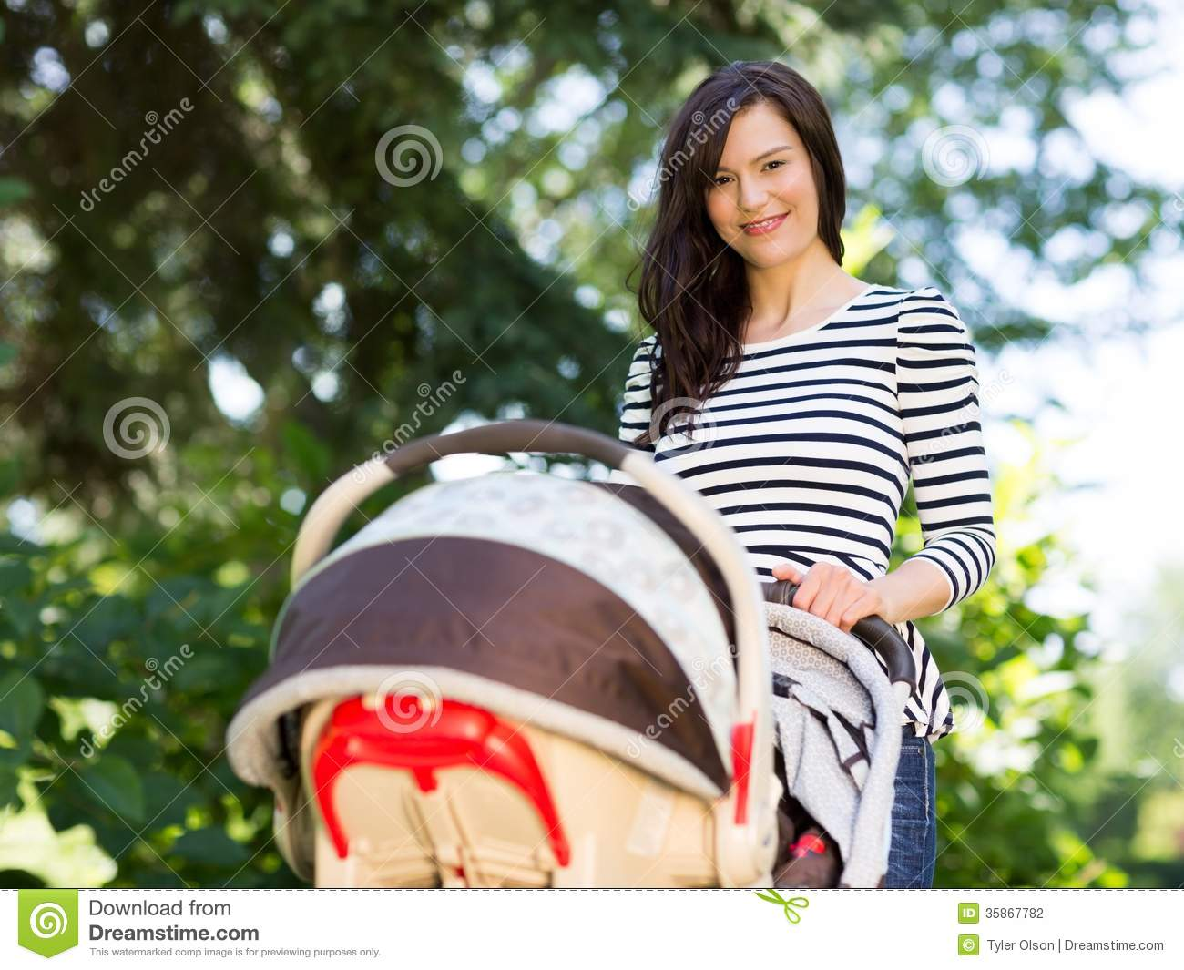 Beautiful Woman Pushing Stroller In Park Stock Photography - Image ...
