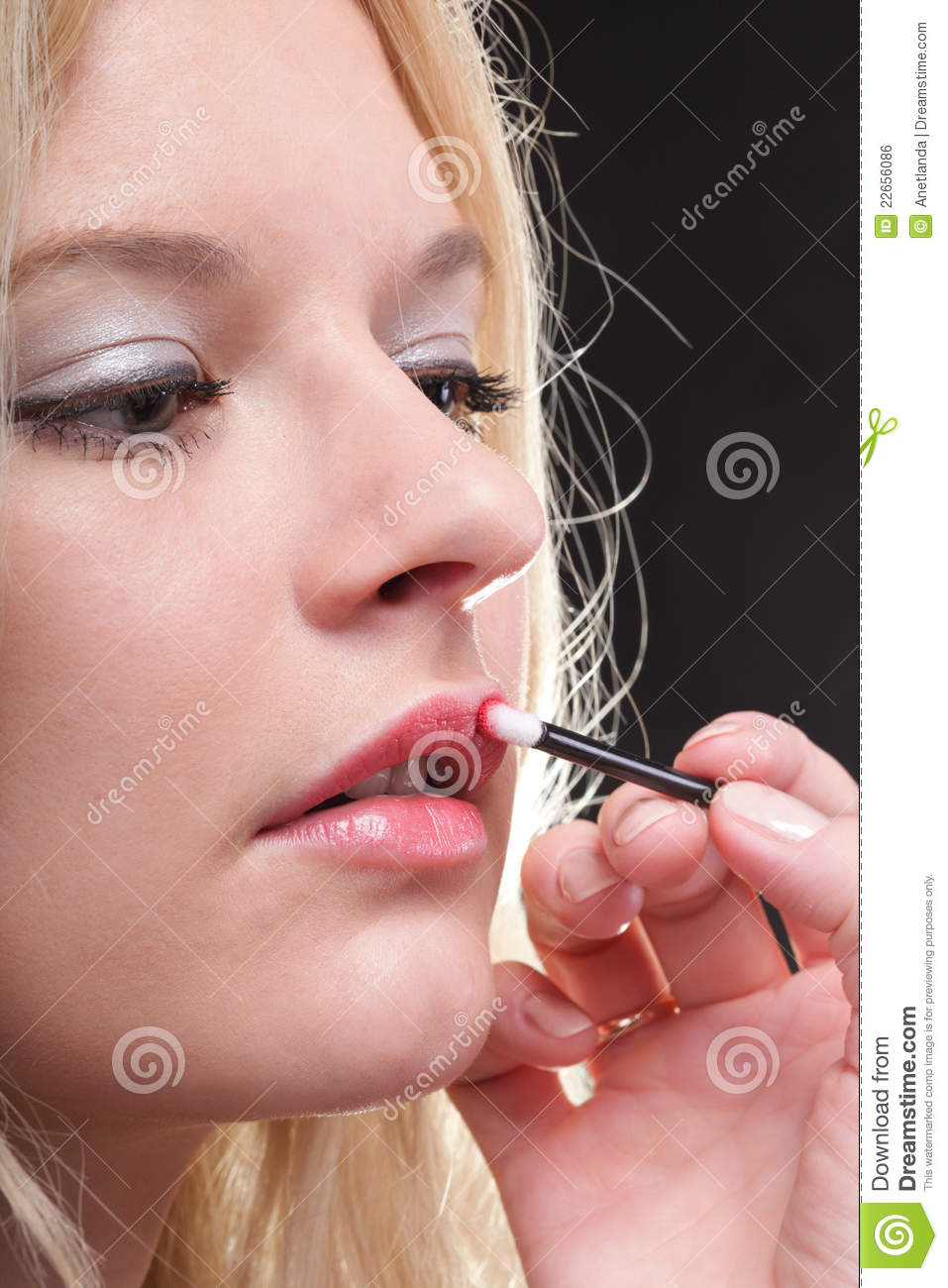 Beautiful Woman Putting On Makeup Royalty Free Stock Image