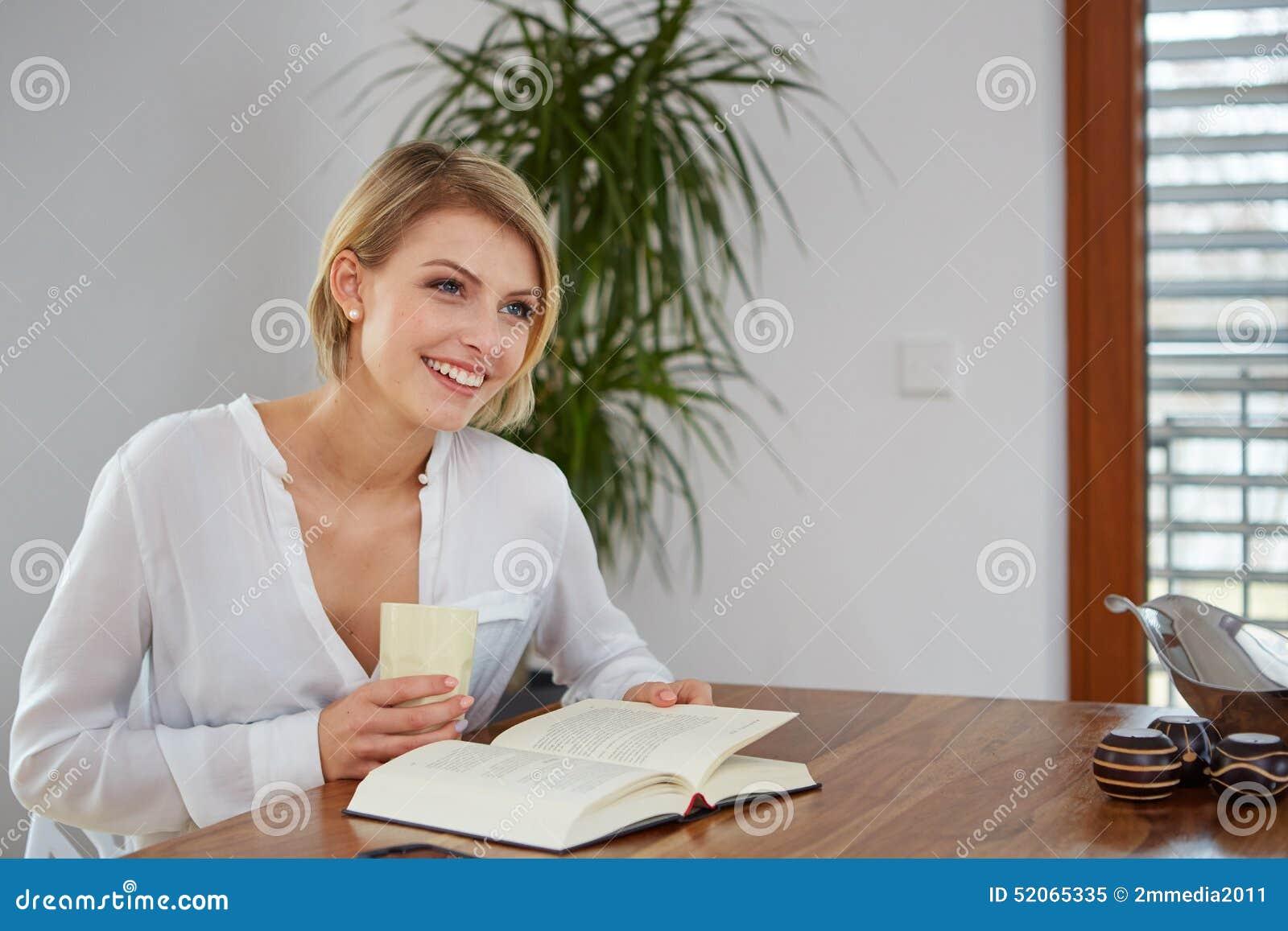 Beautiful woman reading her book