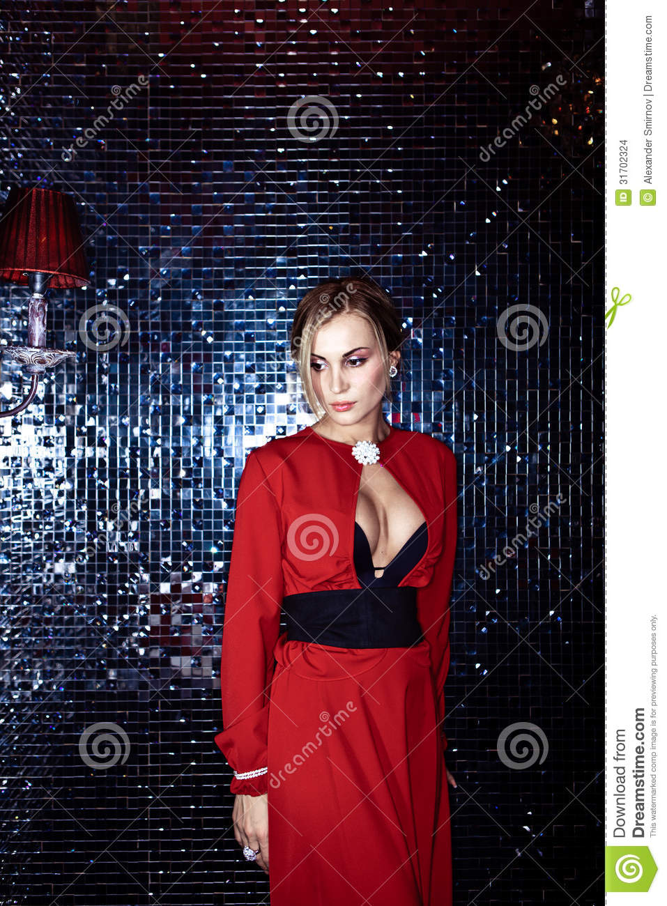 beautiful woman in a red dress stock images