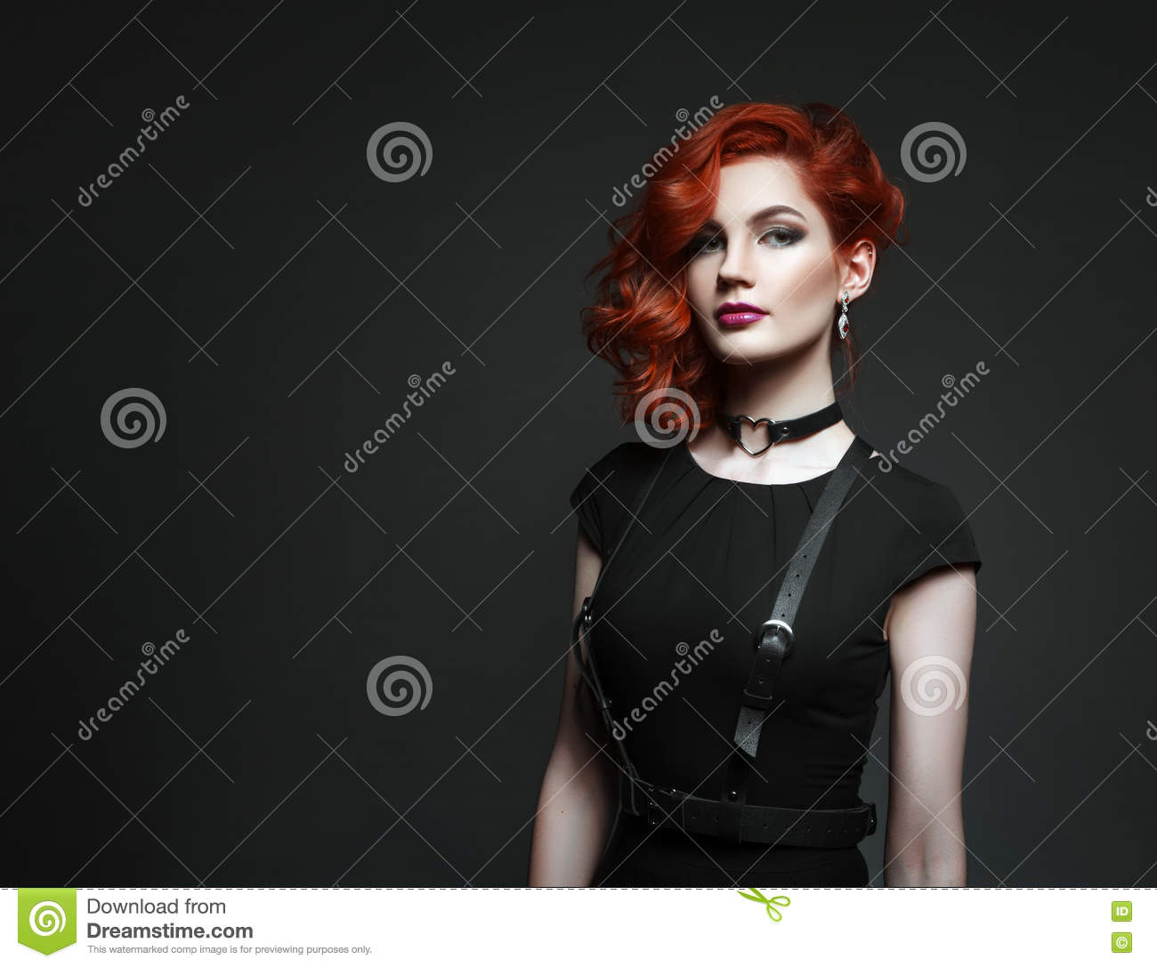 Black dress hairstyle - Beautiful Woman With Red Hair In A Black Dress Stock Photo