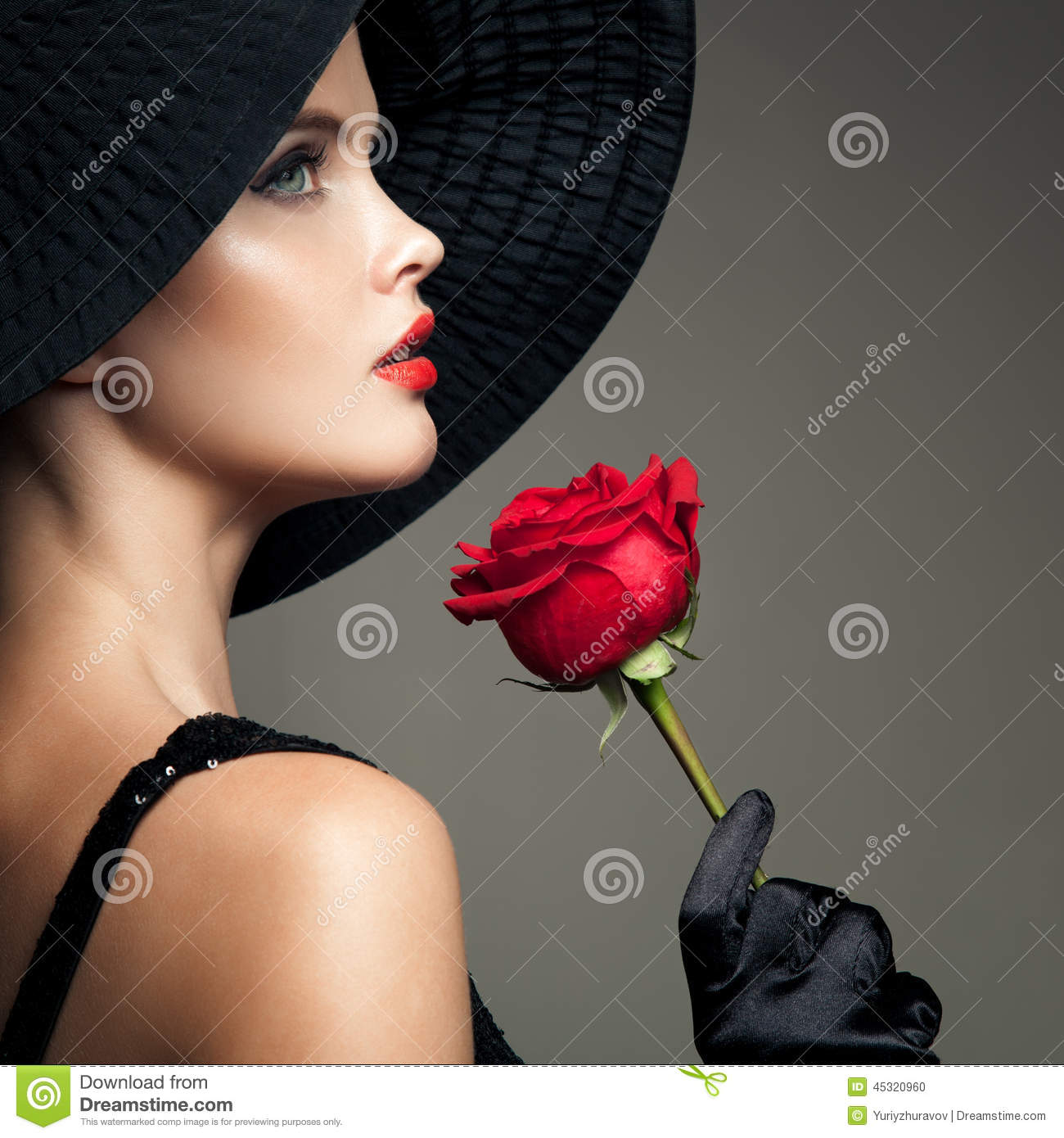 Beautiful Woman With Red Rose. Retro Fashion Image.