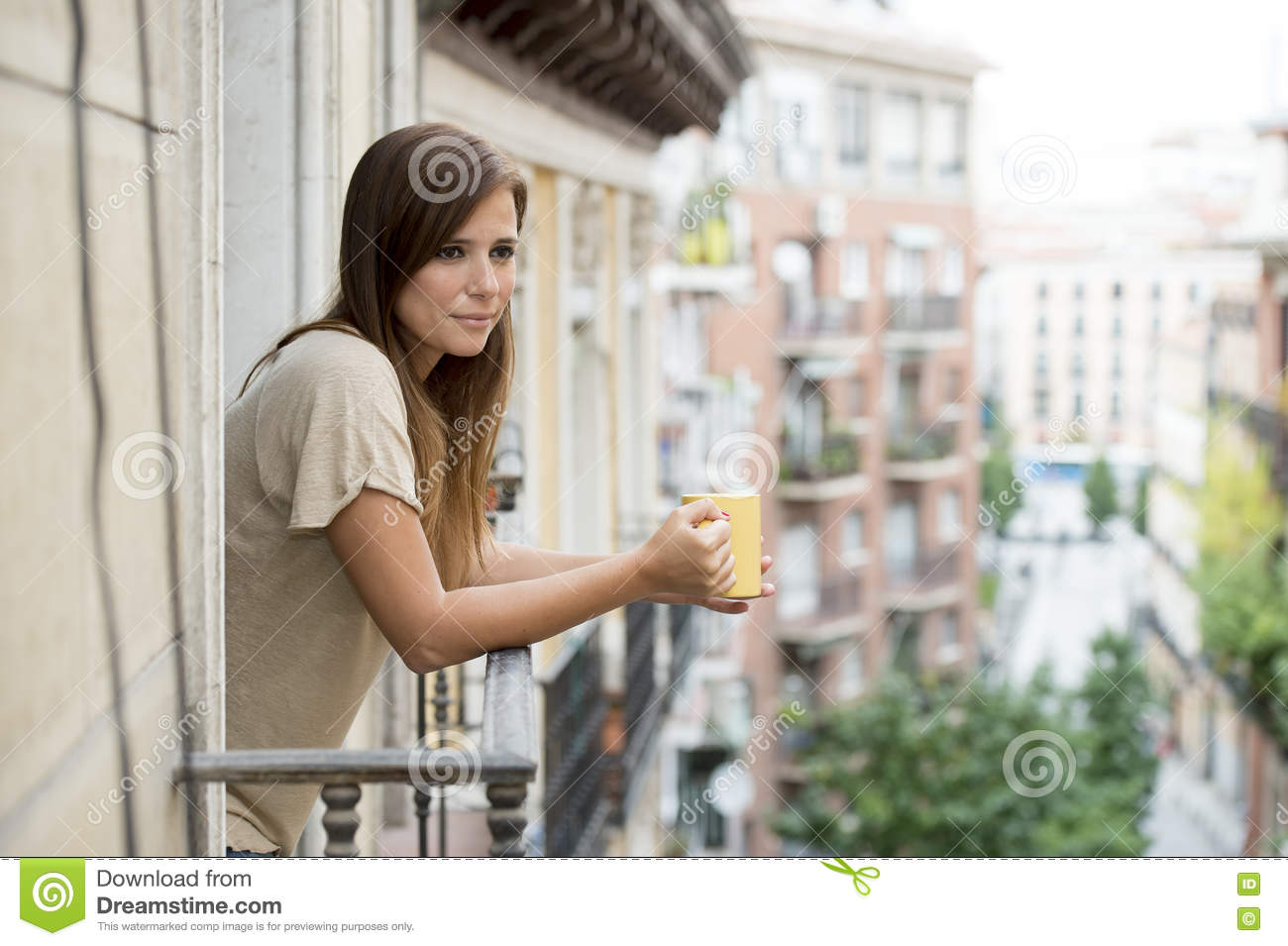 Beautiful woman relaxed cheerful drinking tea coffee at apartment balcony terrace