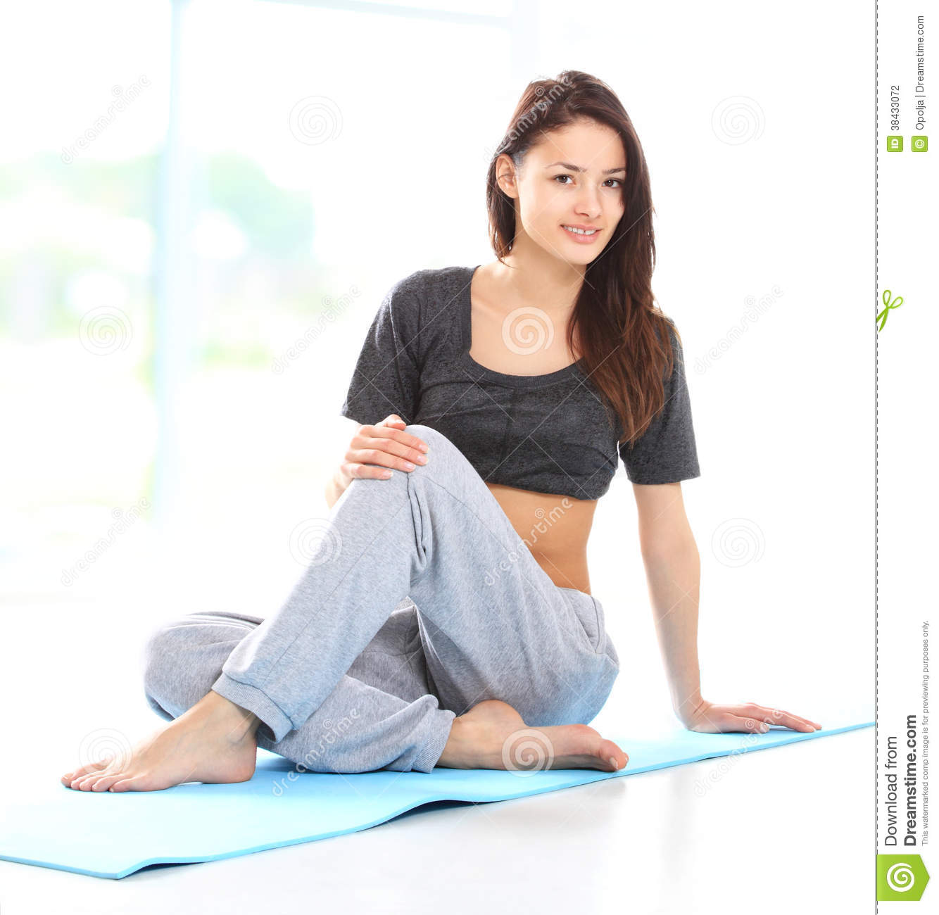 Beautiful Woman Relaxing After Doing Exercise Stock