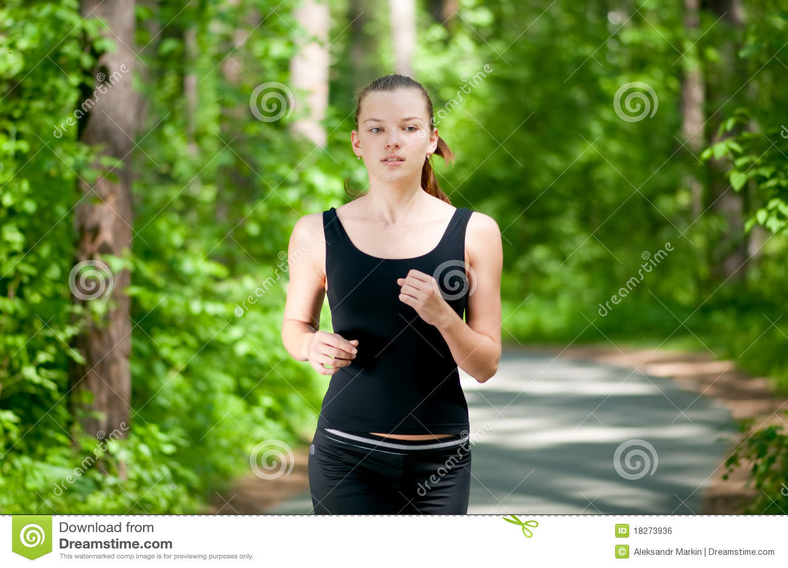beautiful woman running in green park stock photo   image