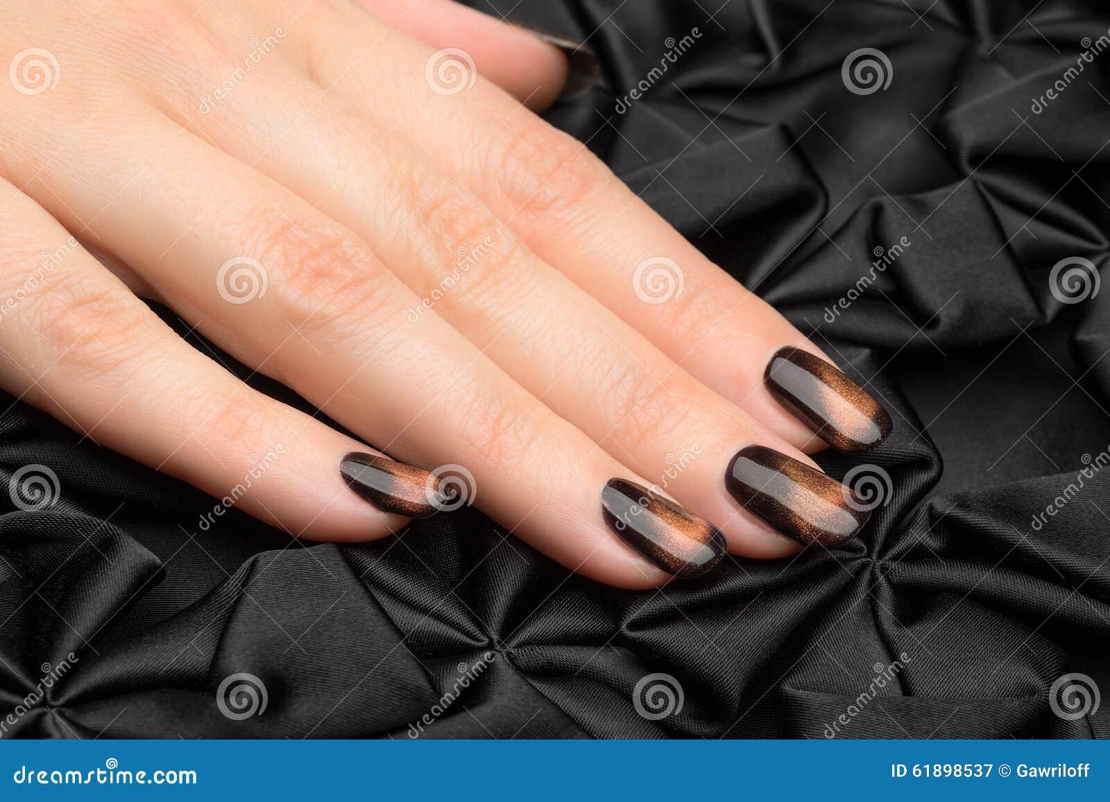 Beautiful woman s nails with nice stylish manicure