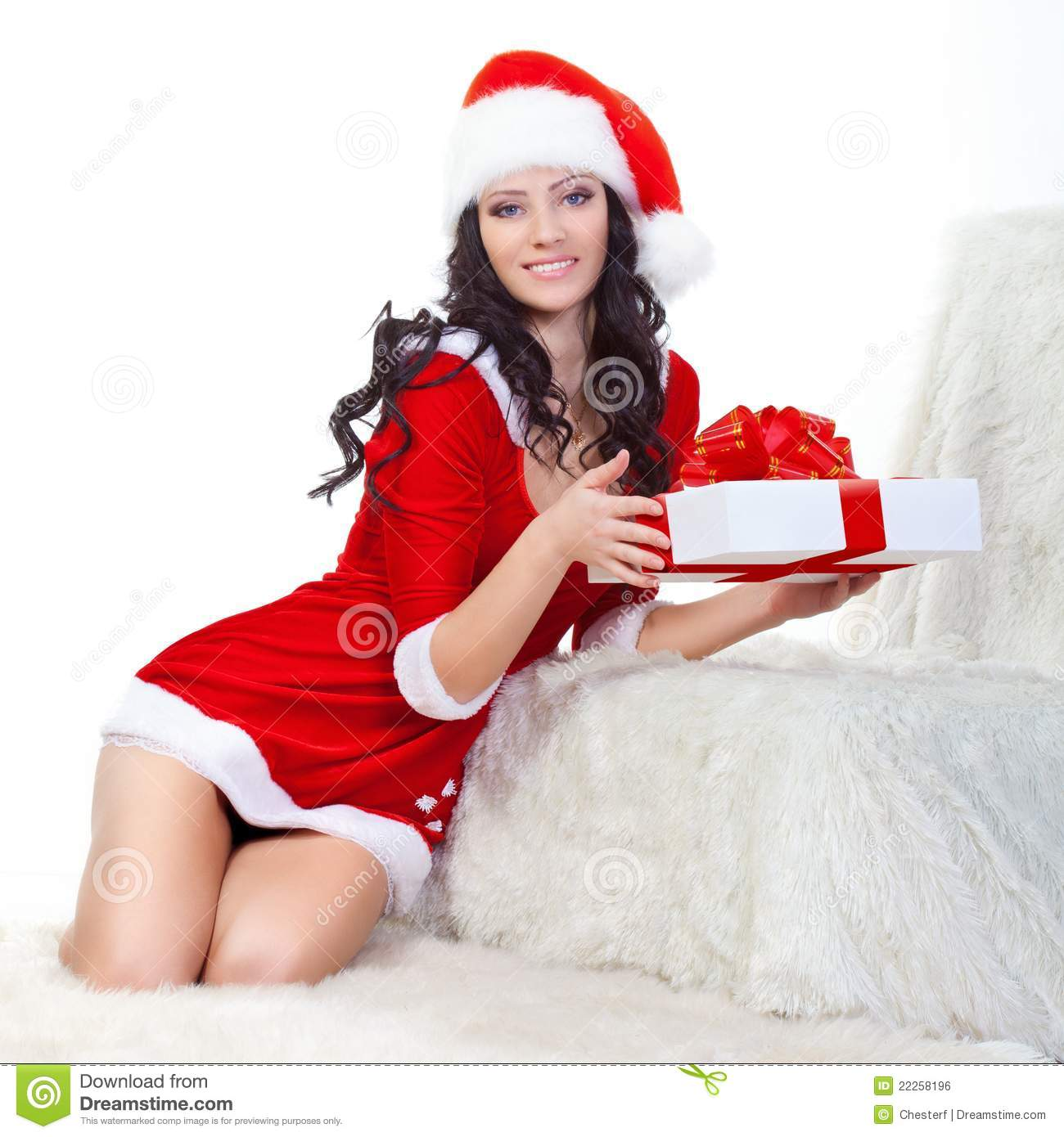 Beautiful Woman In Santa Costume Holding Gift Box Royalty
