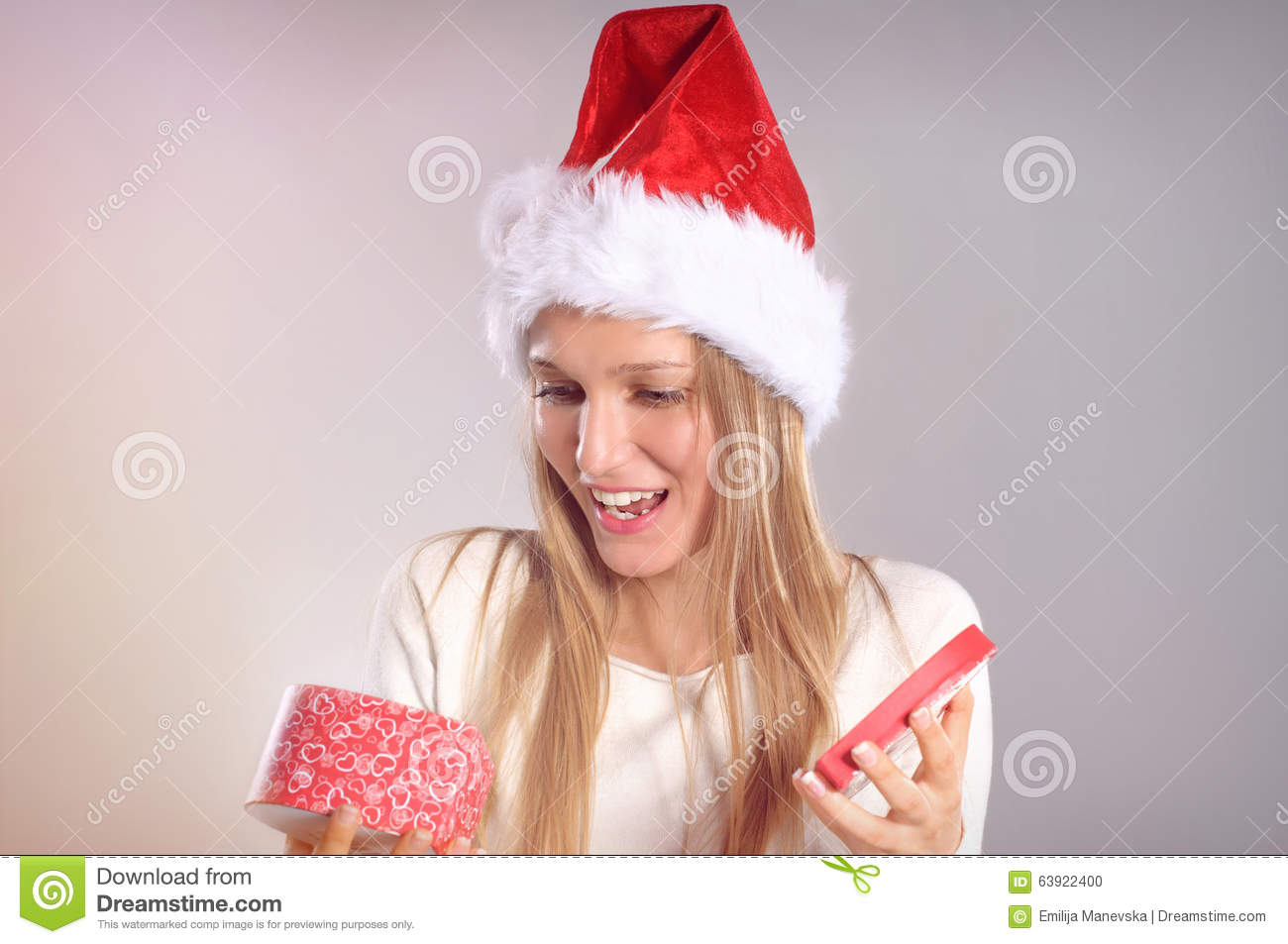 Beautiful Woman With A Santa Hat Opening A Gift Box Stock ...