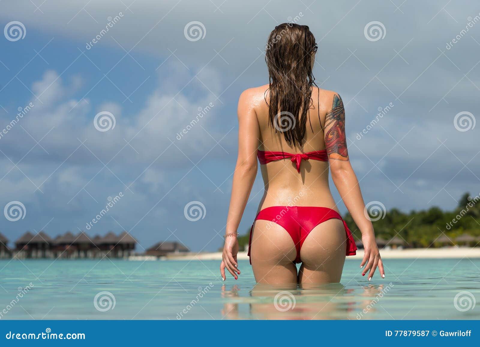 Beautiful woman in bikini over beach background