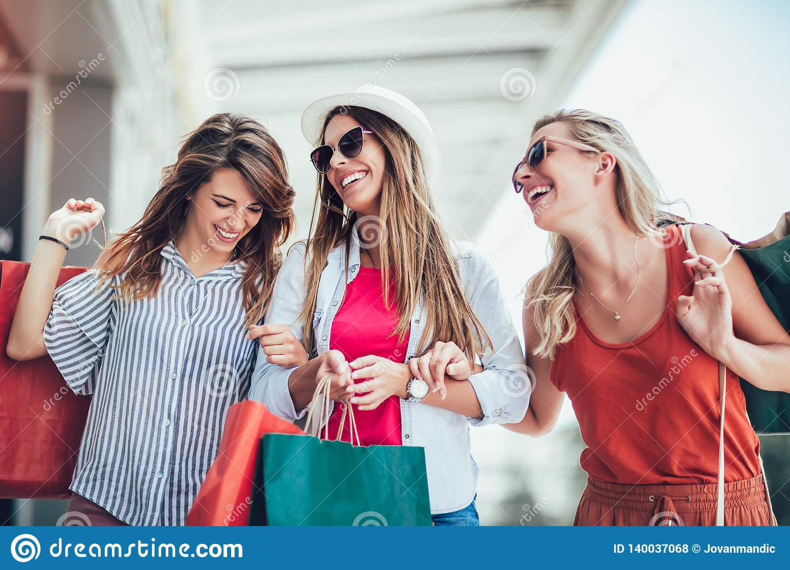 Woman with shopping bags in the city-sale, shopping, tourism and happy people concept