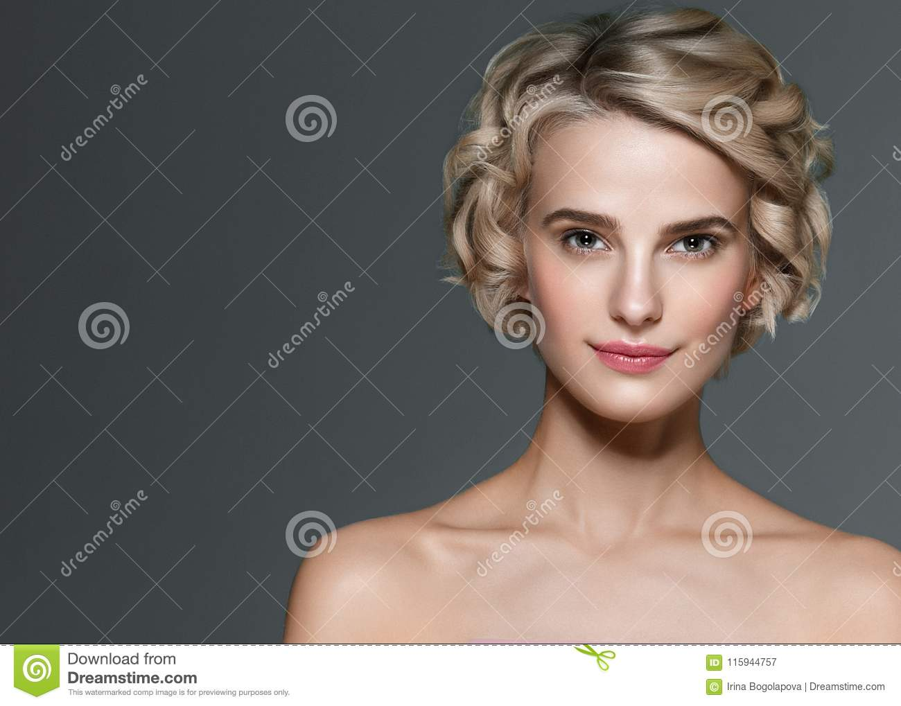 Beautiful woman short blonde hair and hands manicure nails elegant beauty portrait.