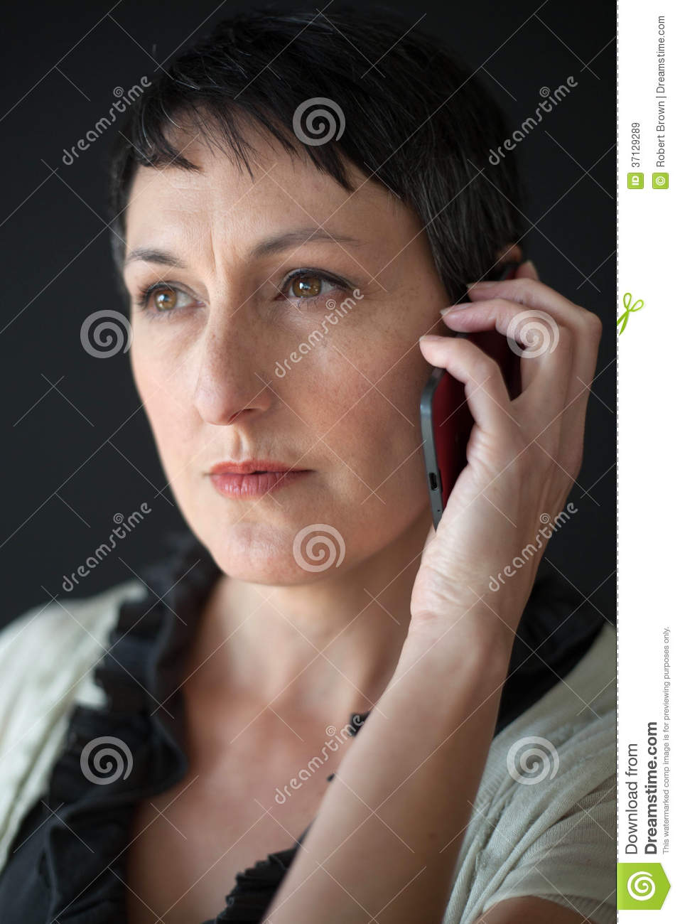 Beautiful Woman With Short Brown Hair Talking On A Cell