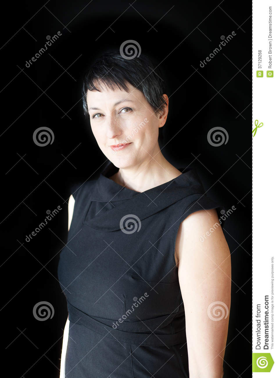 Beautiful Woman With Short Hair On Black Background