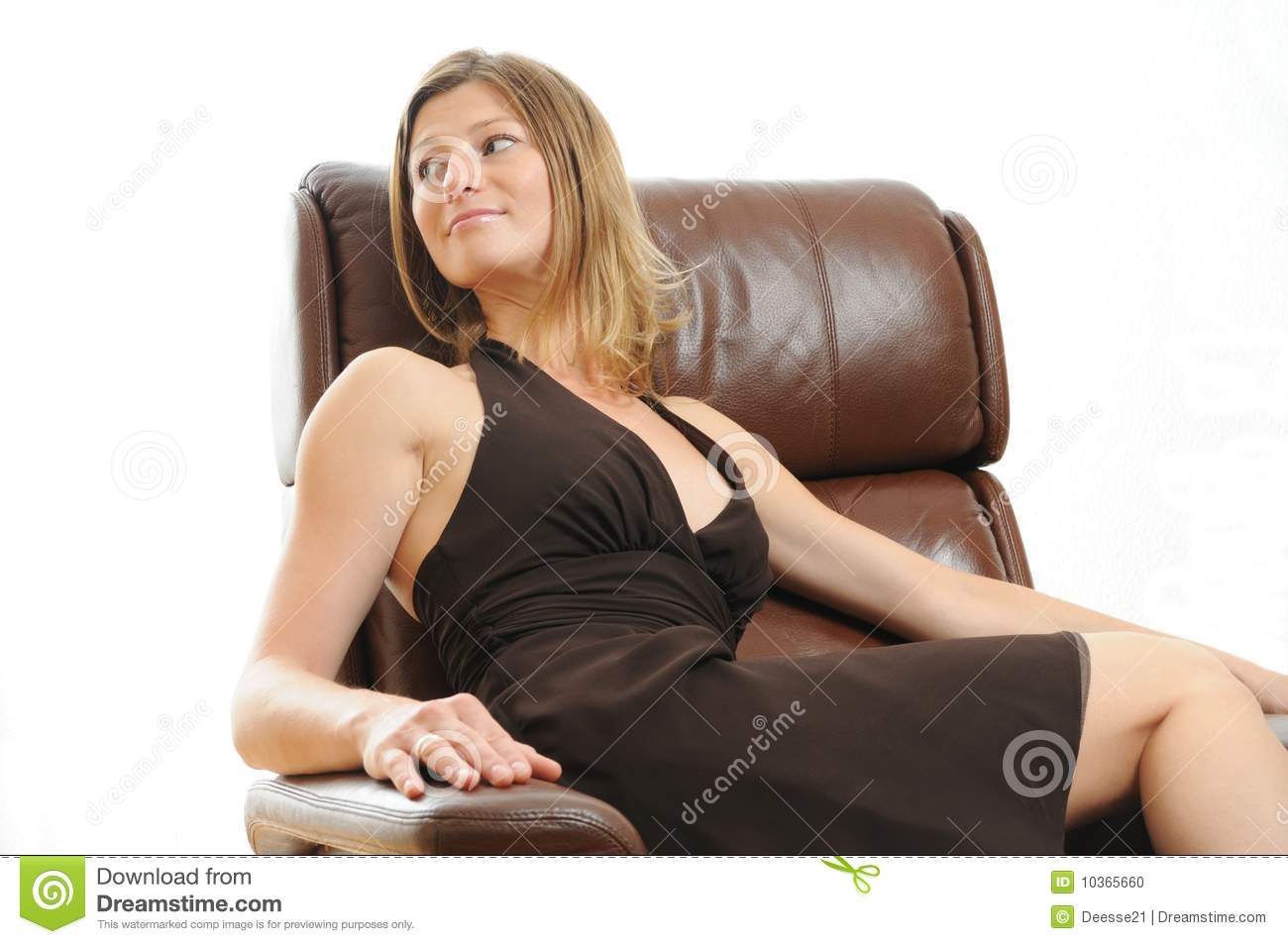 Beautiful woman sitting in an easy chair stock photo for Sitting easy chairs