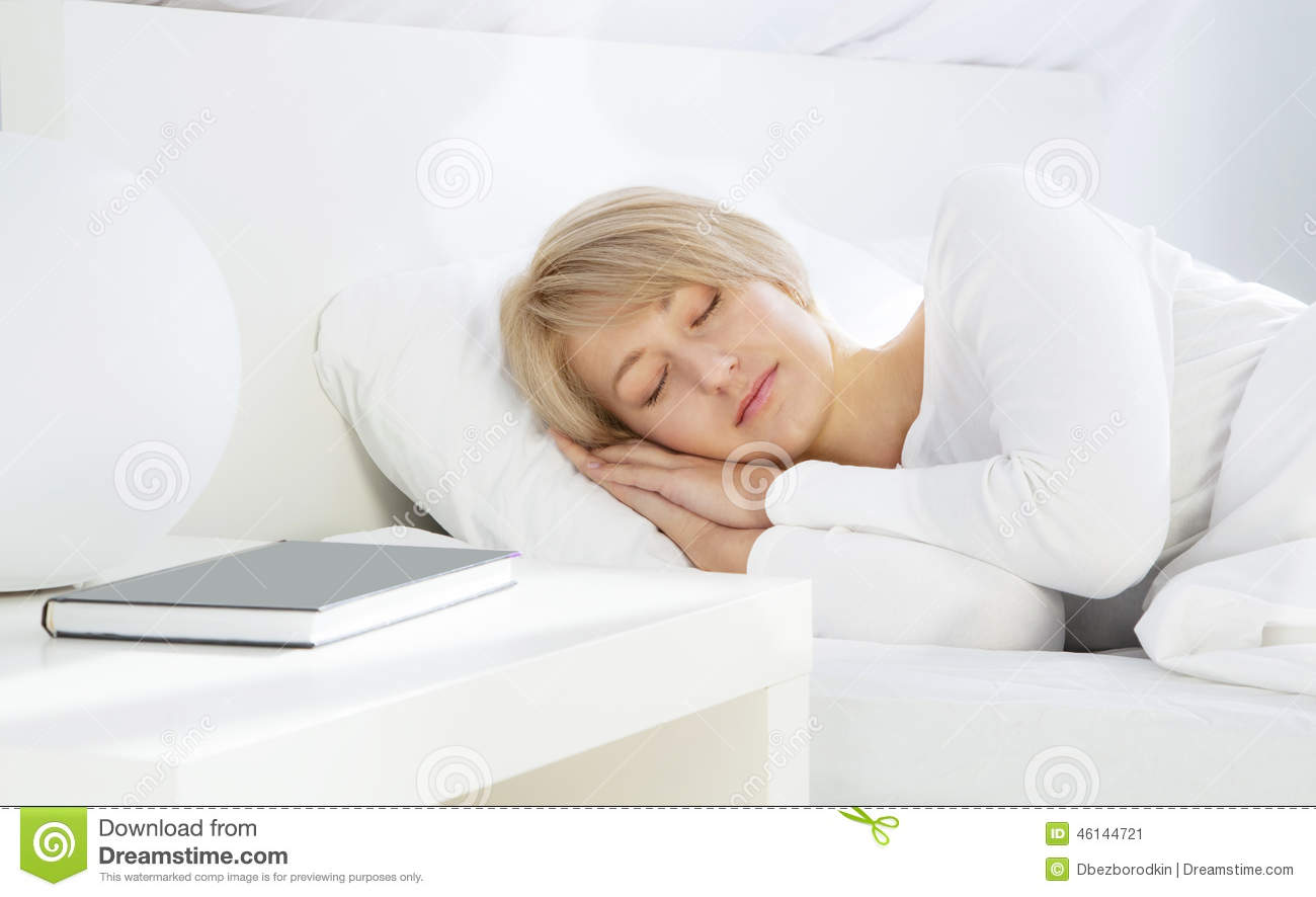 Book Cover White Girl : Beautiful woman sleeping in white bed stock image