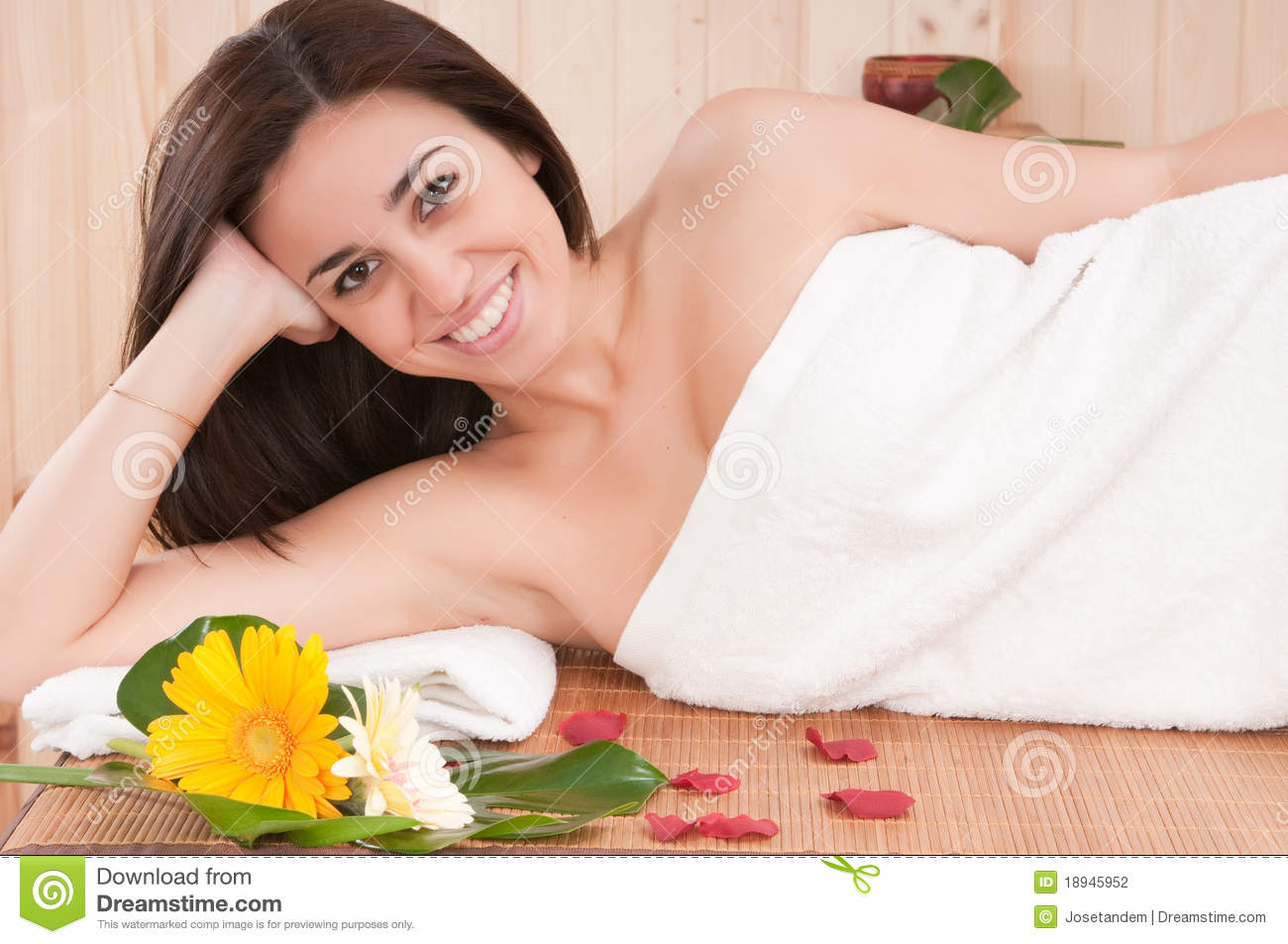 Beautiful woman in spa center having relax