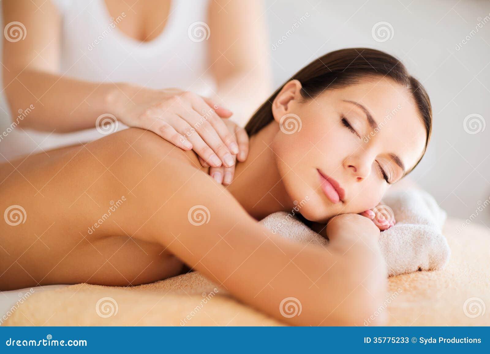 Beautiful woman in spa having massage