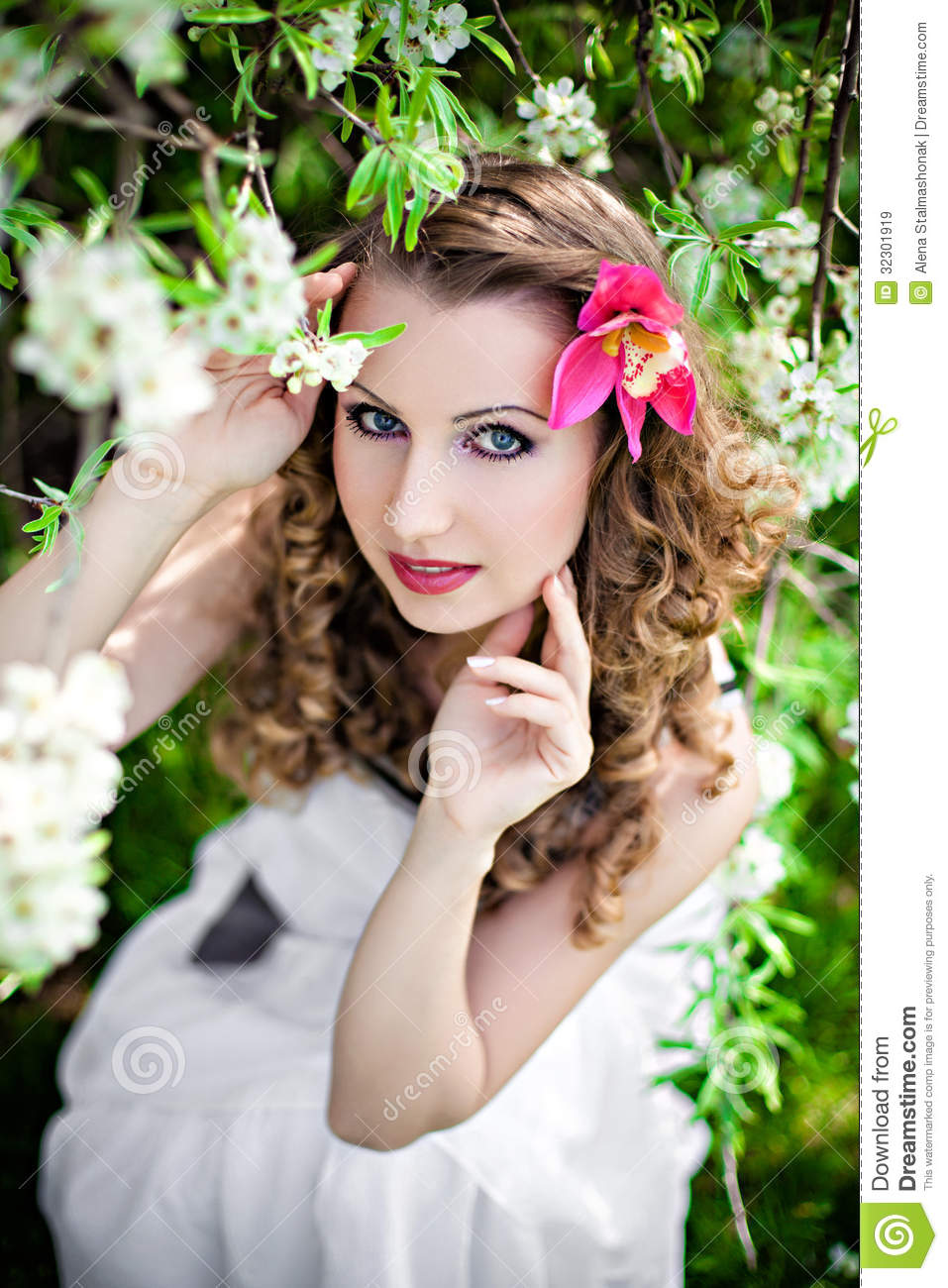 Beautiful woman in spring garden — Stock Photo © Forewer