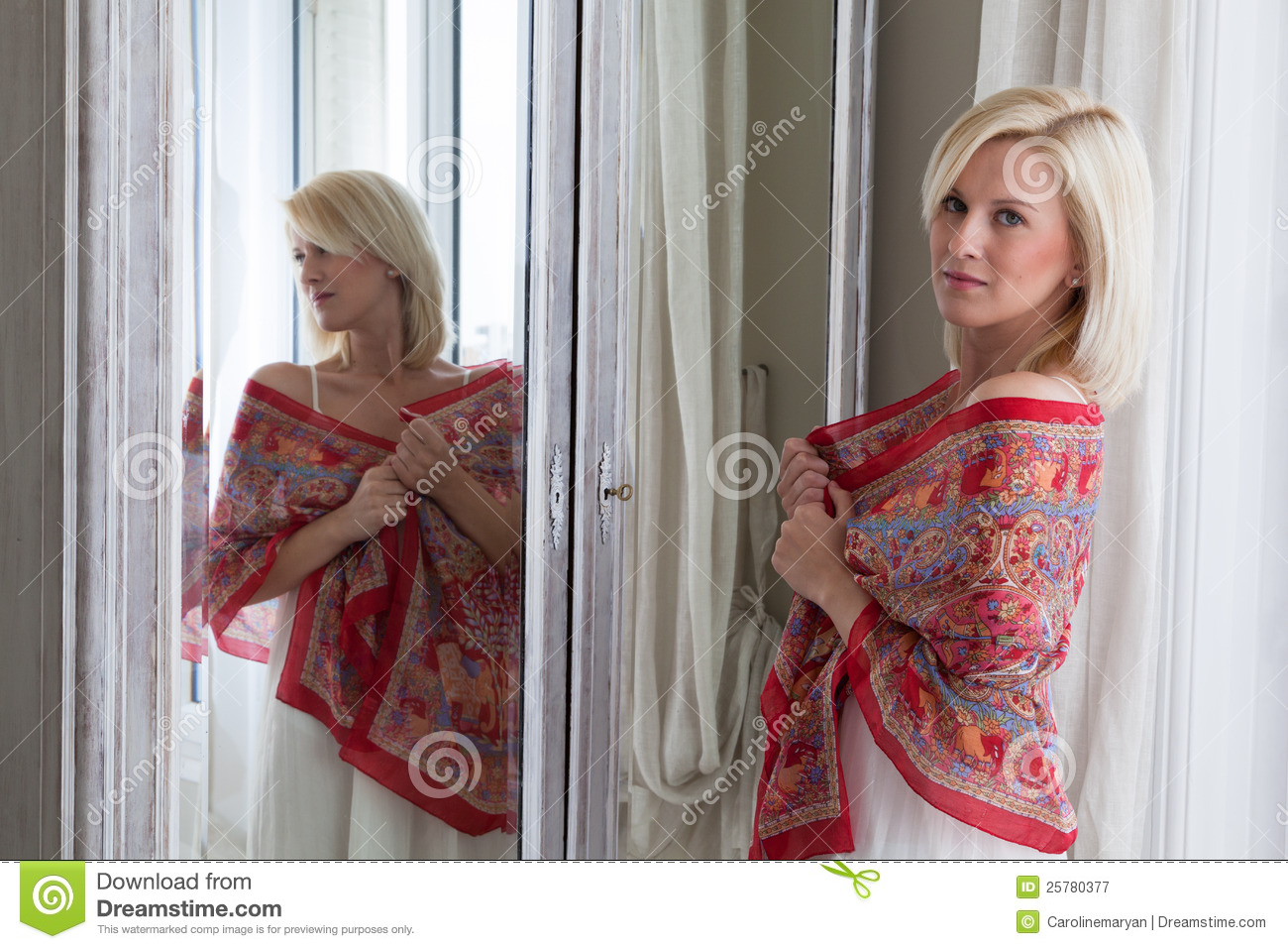 Beautiful Woman Standing In Front Of Mirror Stock Image