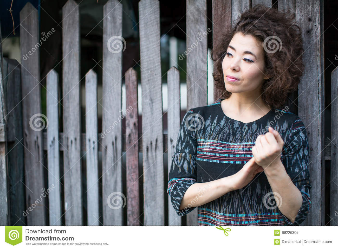 asian single women in fence Download sitting on the fence stock photos affordable and search from millions of royalty free images, photos and vectors.