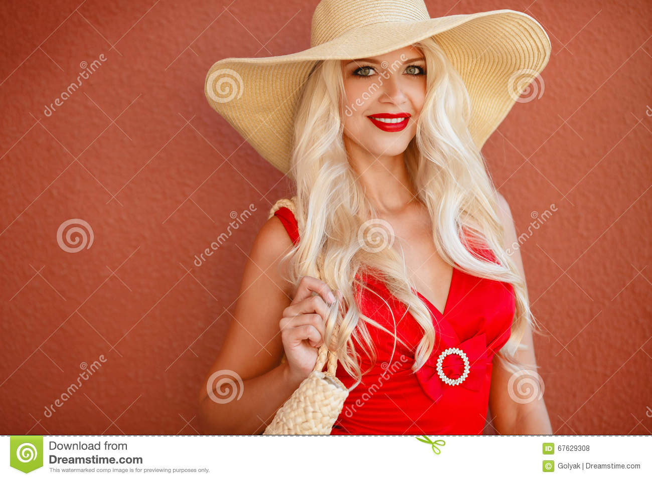 Beautiful woman in straw hat with large brim