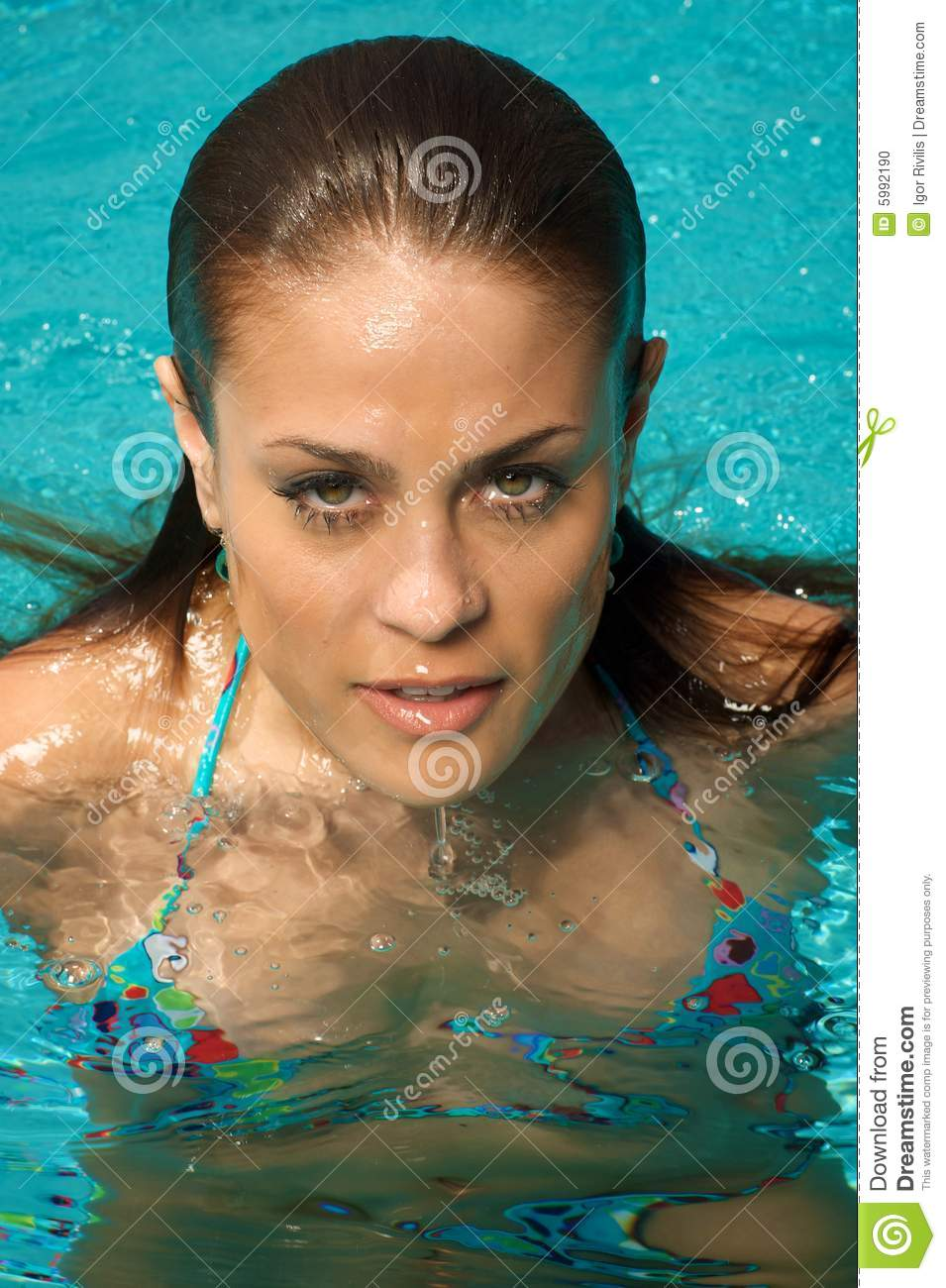 Beautiful young woman relaxing near the swimming pool Swimming pool beautiful