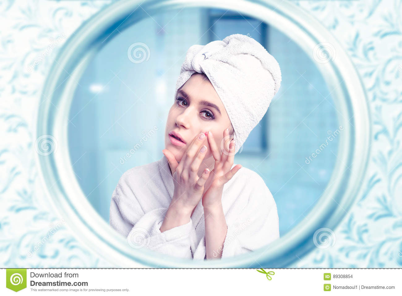 Beautiful woman take care of face against mirror