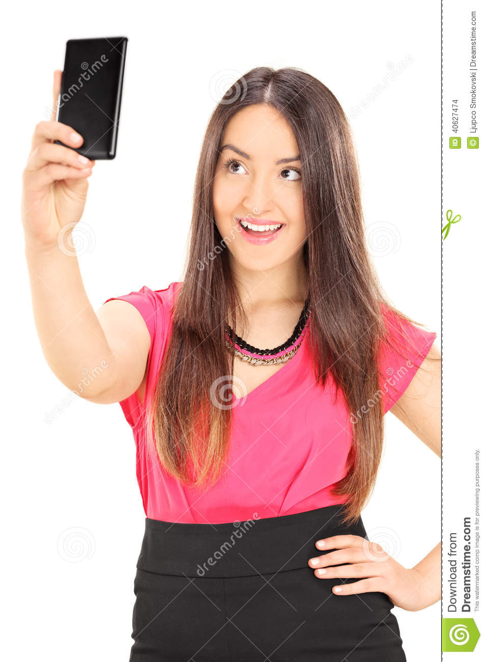 Beautiful woman taking a selfie with cell phone