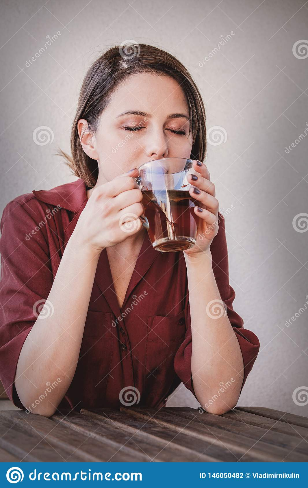 Beautiful woman with tea  cup at home in a morning