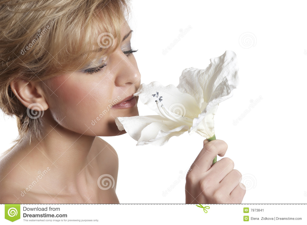 Beautiful woman to smell flower. close up