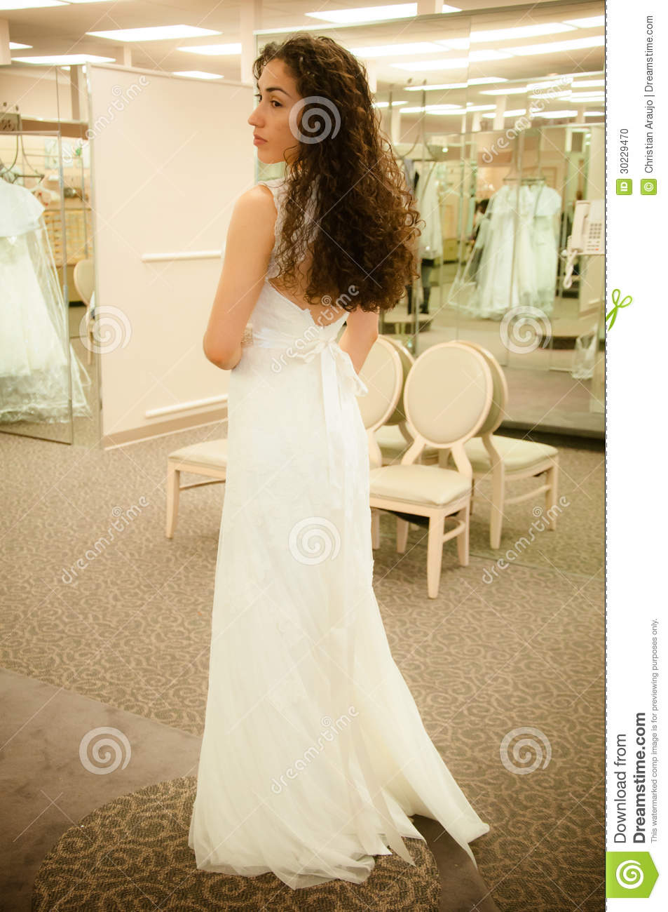 Trying wedding dress stock photo image 30229470 for Woman in wedding dress