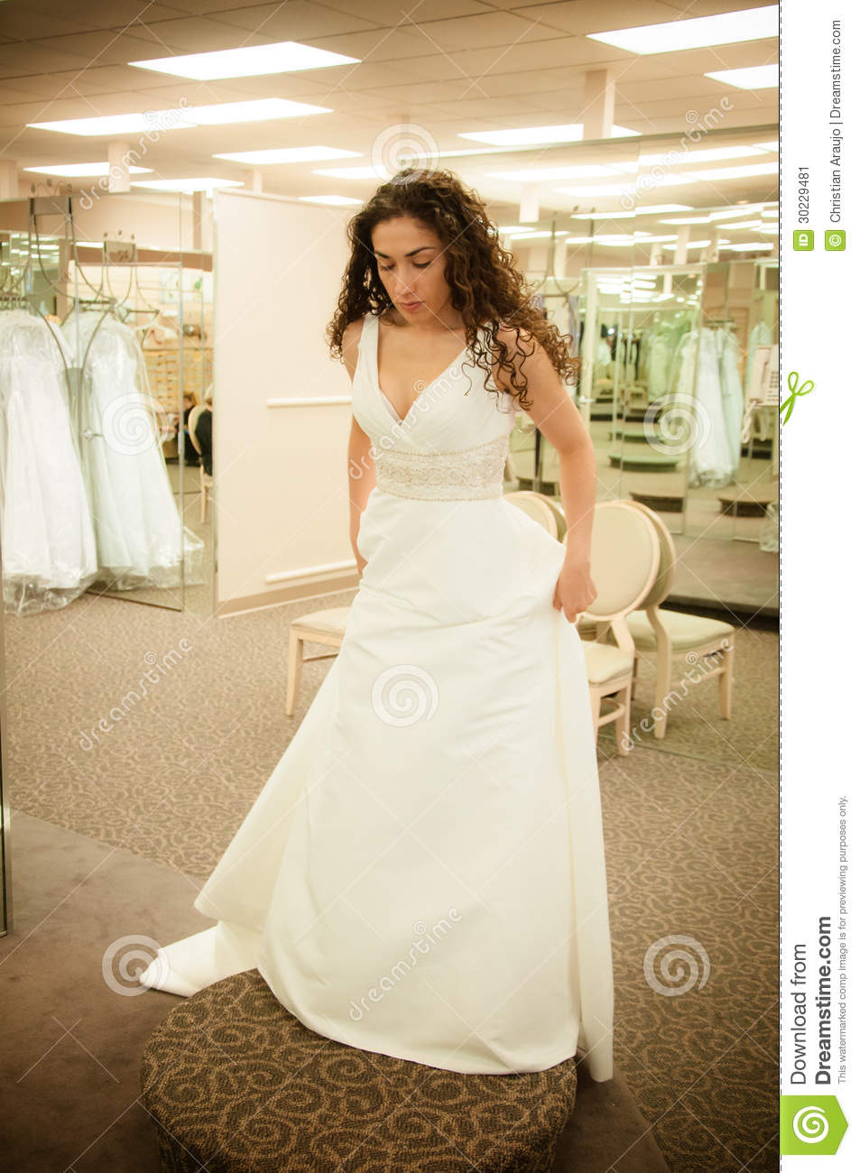 Trying wedding dress stock image image 30229481 for Wedding dress in stock