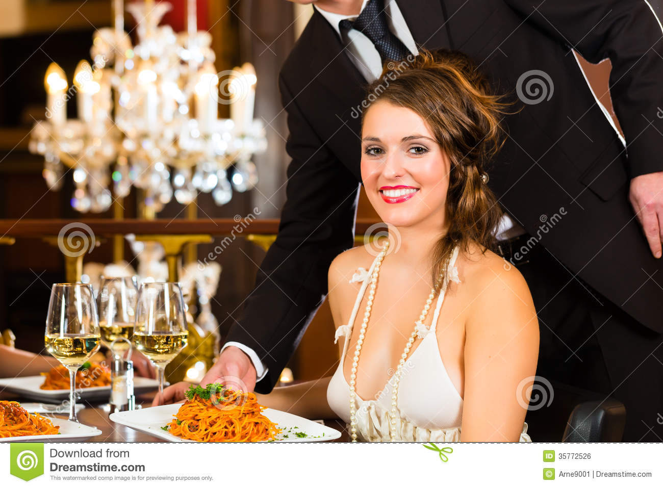 Beautiful Woman And Waiter In Fine Dining Restaurant Royalty Free ...