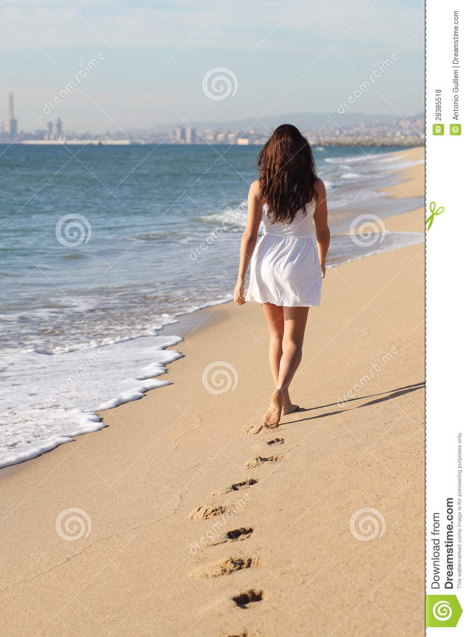 Woman walking on a beach royalty - Back Beach Beautiful Footprints Walking Woman