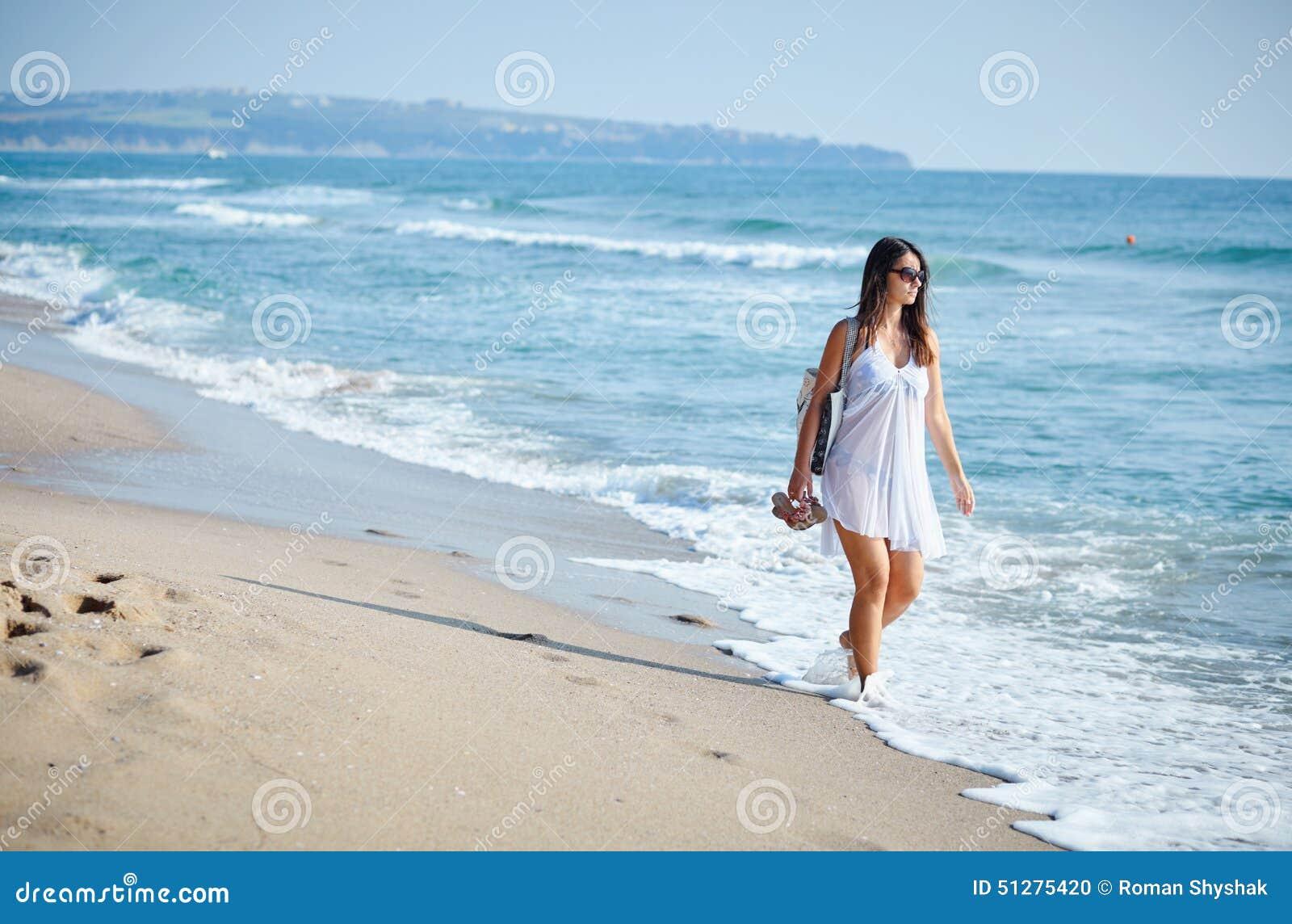 Beautiful Woman Walking On A Beach Stock Photo - Image of ...