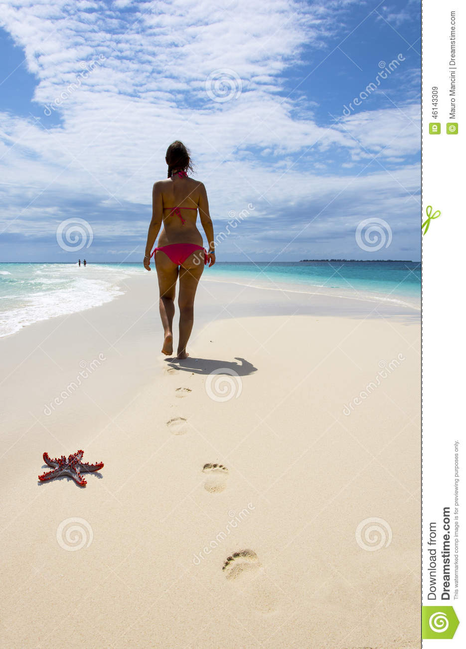 Woman walking on a beach royalty - Royalty Free Stock Photo Download Beautiful Woman Walking On The Beach