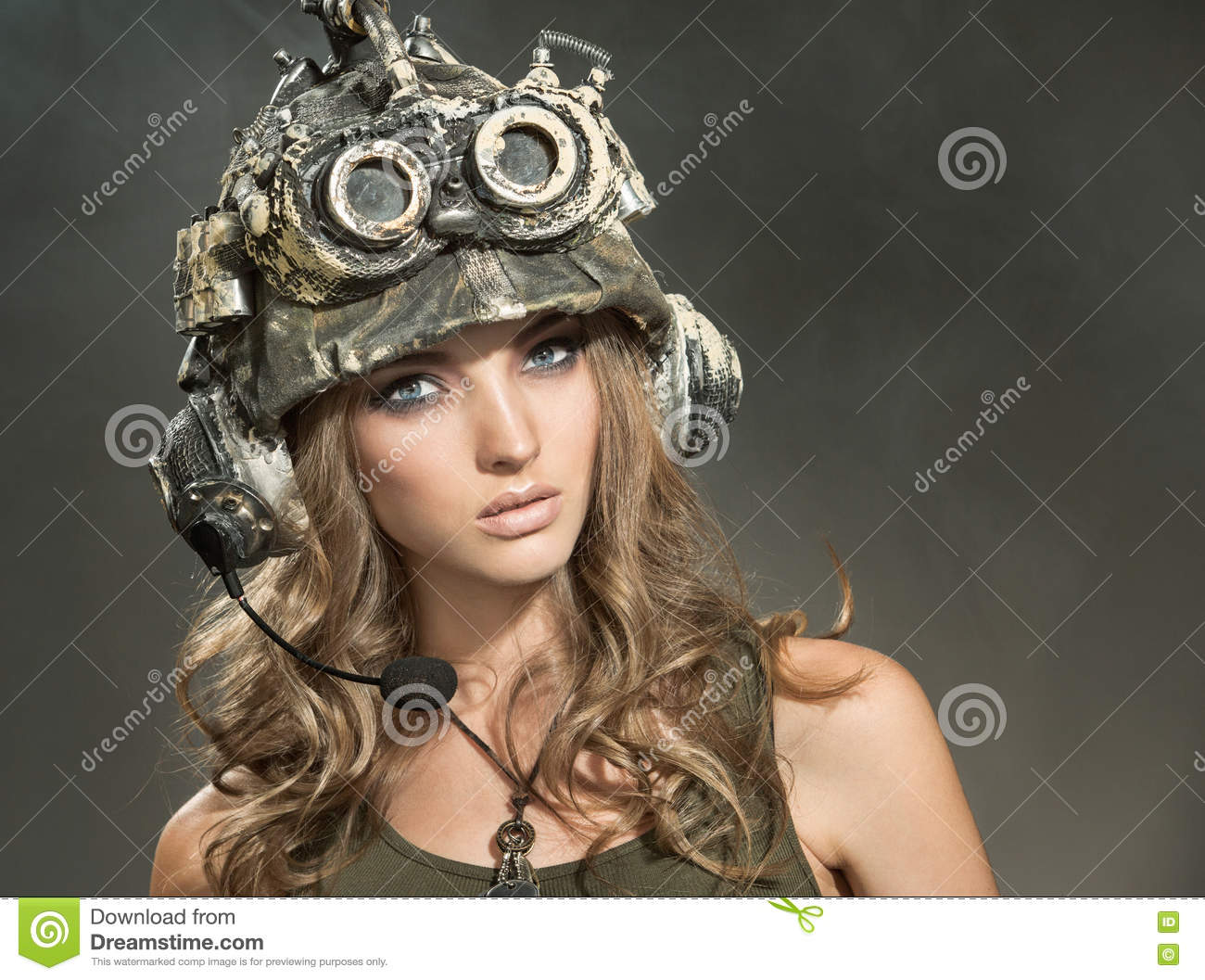 Beautiful woman warrior in a helmet