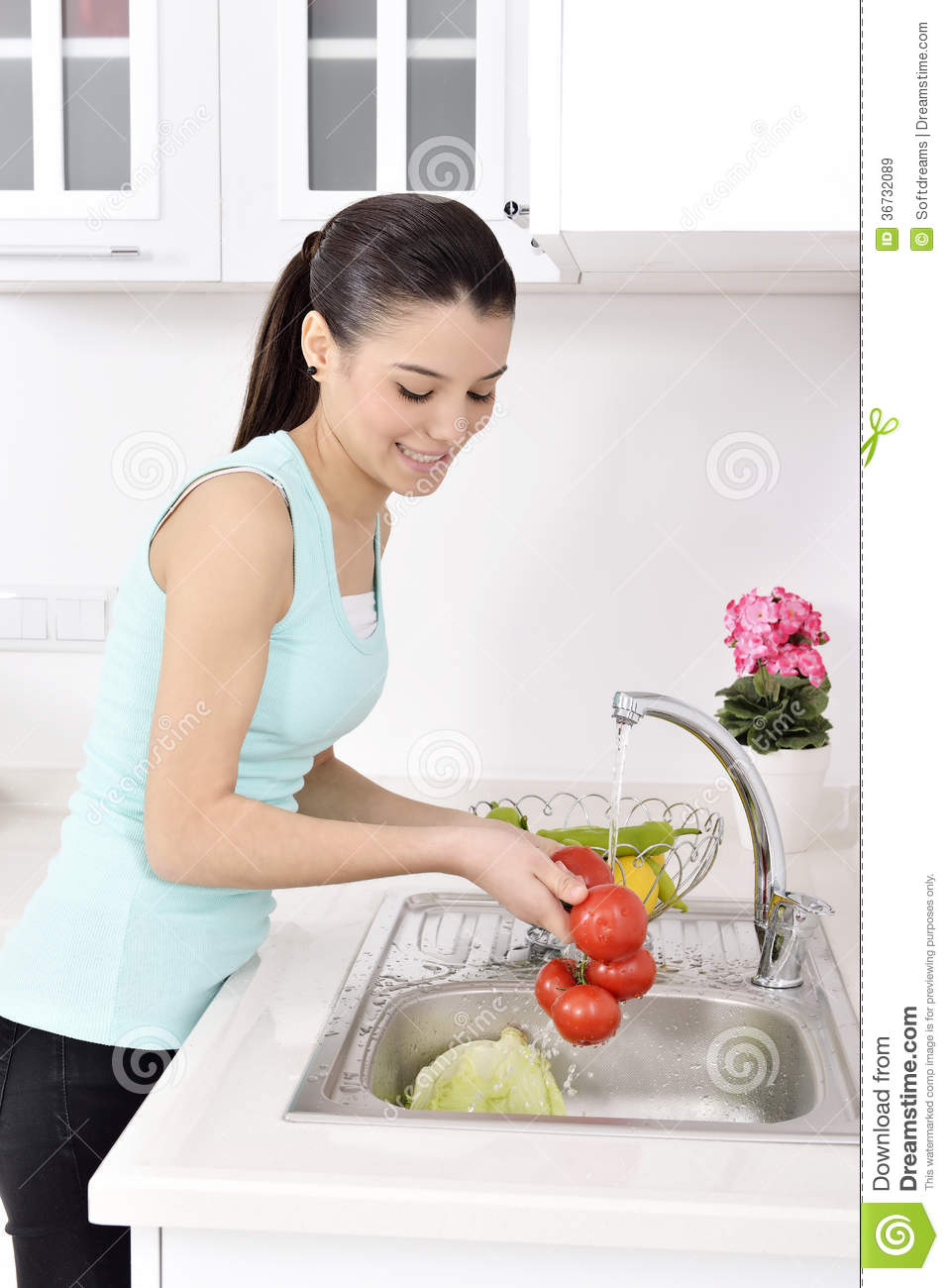 Beautiful Woman Washing Vegetables Royalty Free Stock